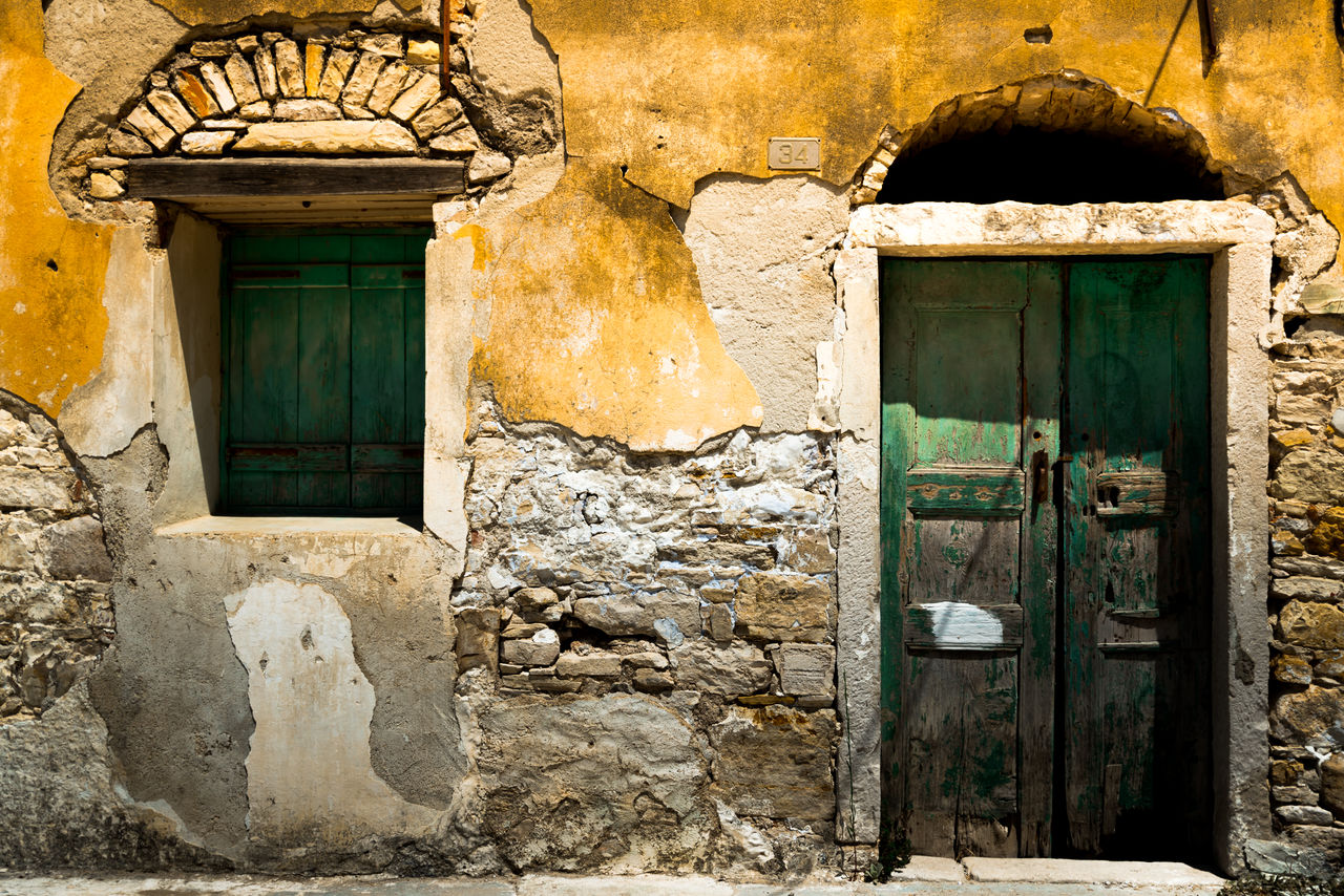 architecture, built structure, door, building exterior, entrance, window, building, house, no people, old, day, closed, doorway, open, outdoors, wall - building feature, wall, history, security, the past, stone wall