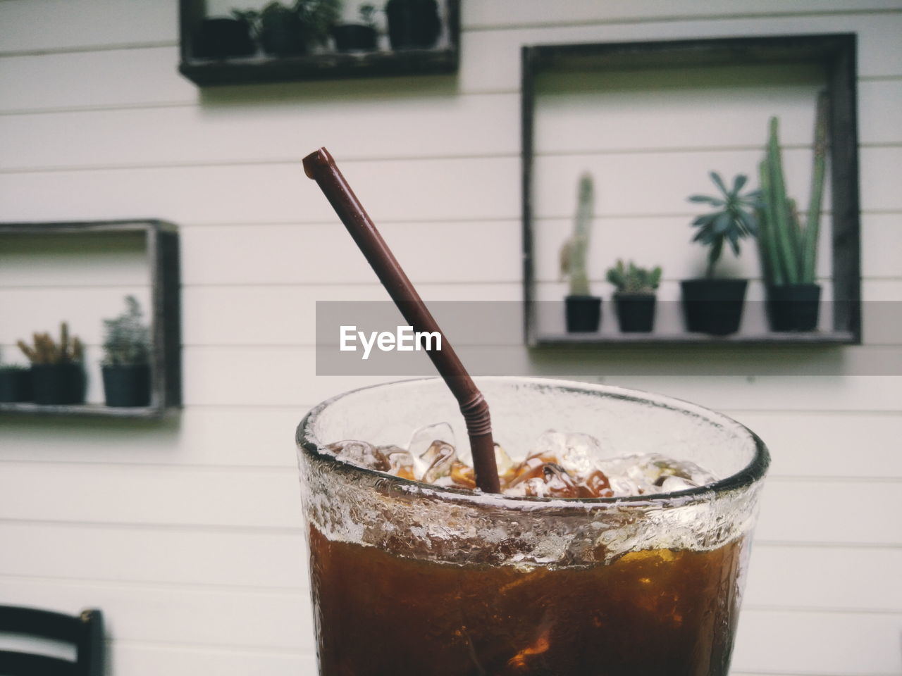 drink, drinking straw, refreshment, focus on foreground, coffee - drink, close-up, food and drink, iced coffee, drinking glass, table, no people, disposable cup, day, freshness, outdoors, frothy drink