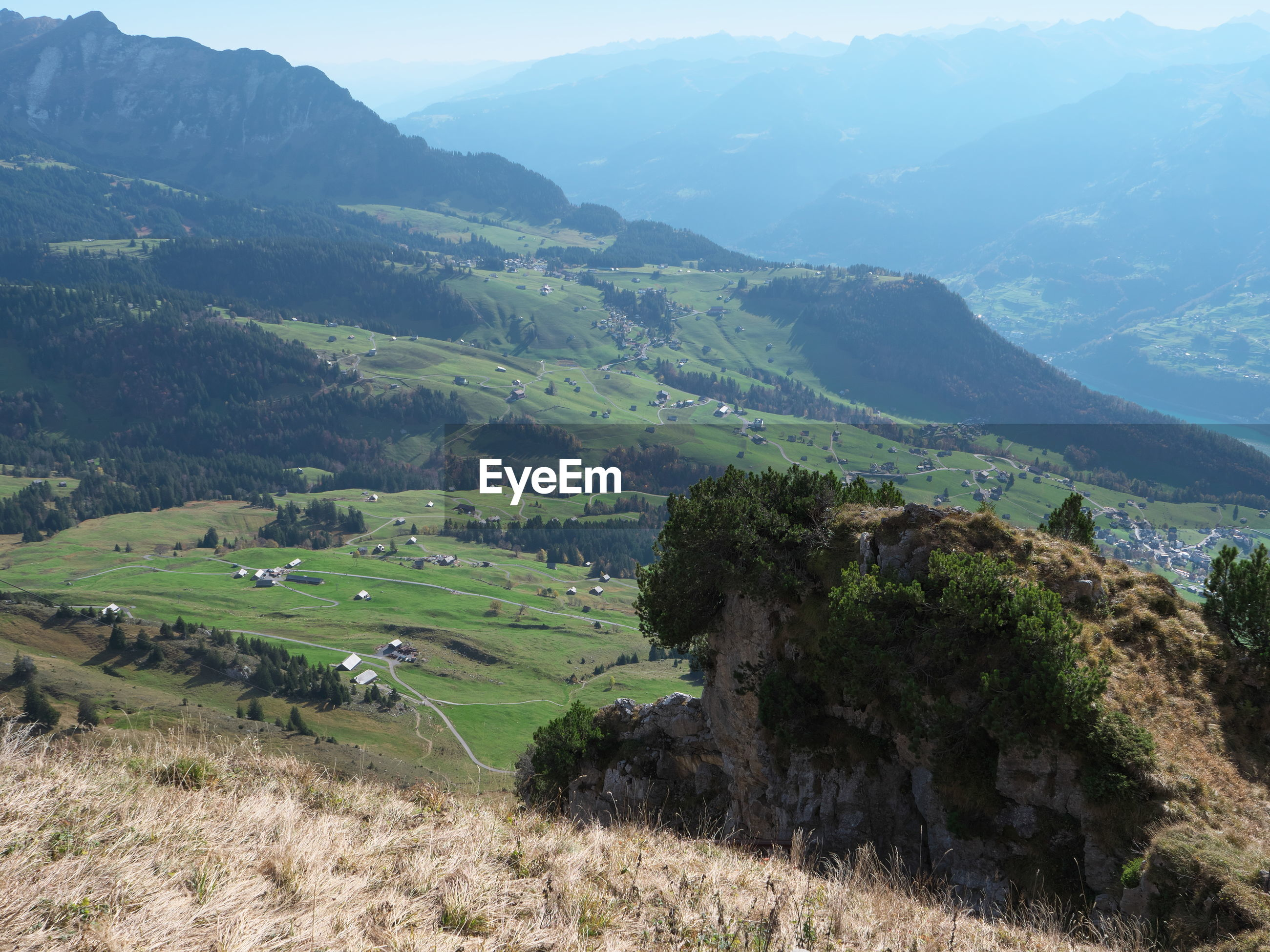 SCENIC VIEW OF LANDSCAPE AND MOUNTAIN