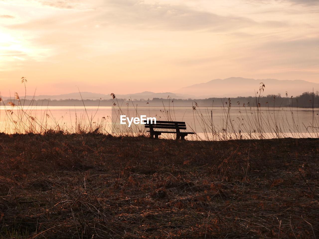 sky, water, sunset, tranquility, scenics - nature, beauty in nature, tranquil scene, nature, cloud - sky, non-urban scene, beach, land, lake, no people, idyllic, outdoors, grass, plant, orange color