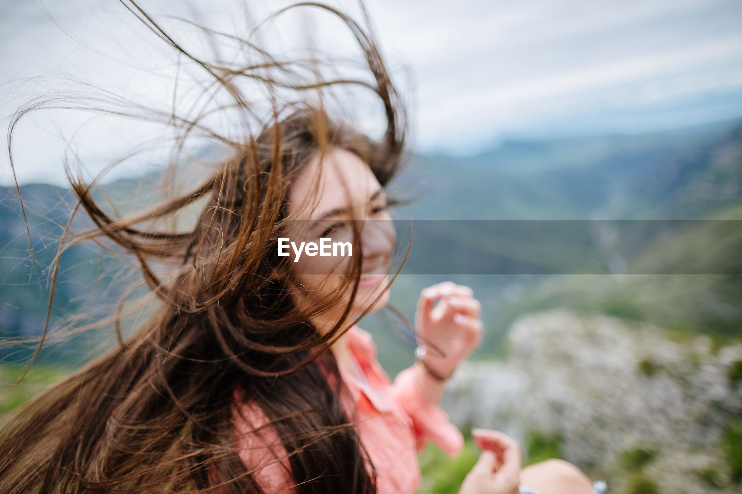 Close-up of young woman in wind