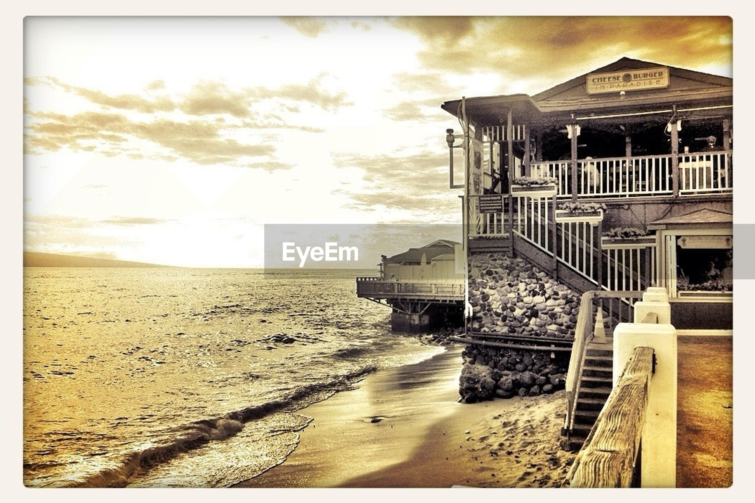 sea, beach, water, built structure, sand, sky, architecture, horizon over water, shore, building exterior, sunlight, cloud - sky, auto post production filter, tranquility, pier, nature, scenics, tranquil scene, wood - material, transfer print