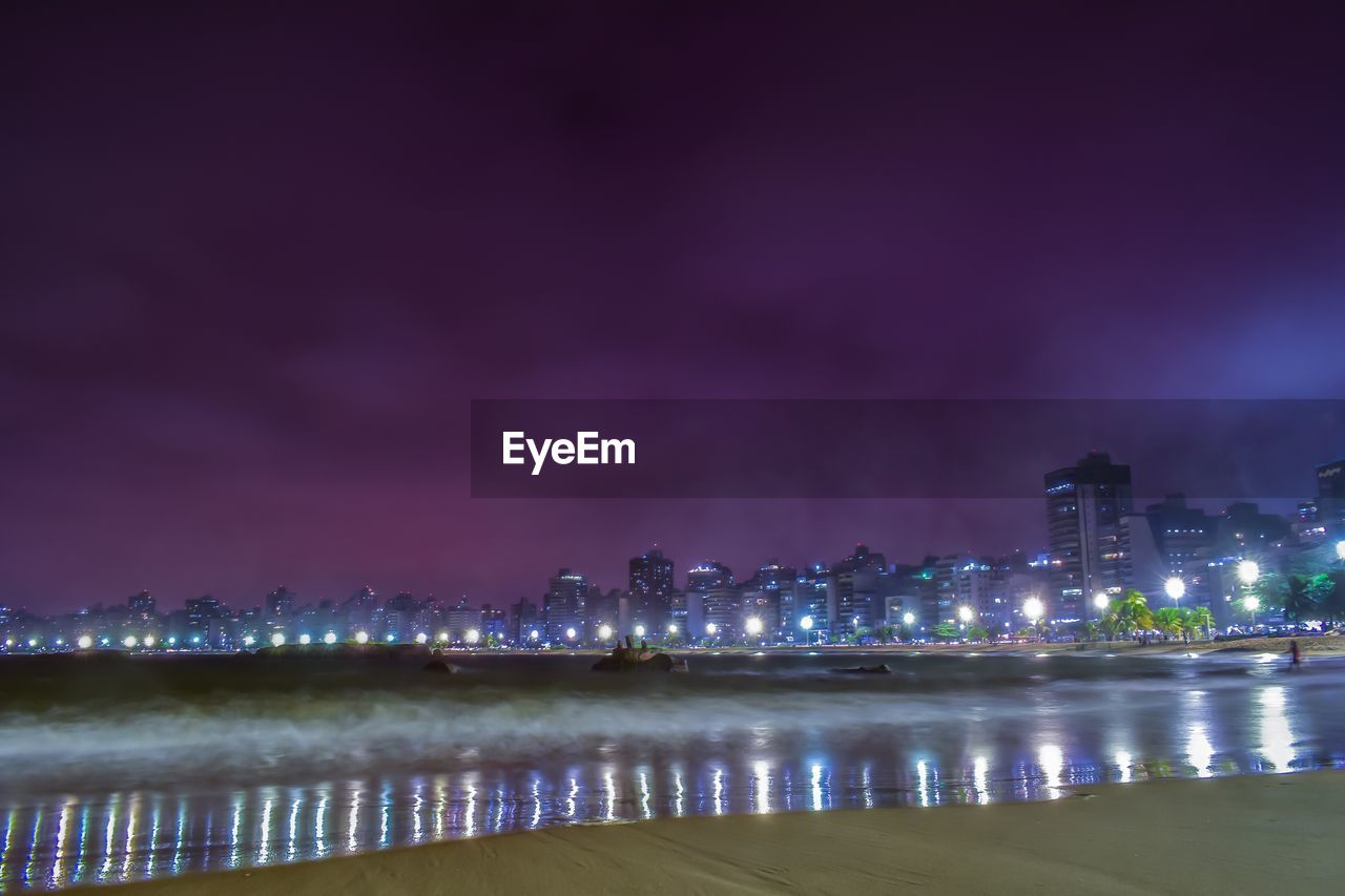 building exterior, night, illuminated, architecture, built structure, water, sky, city, waterfront, nature, building, no people, reflection, cloud - sky, outdoors, river, glowing, residential district, cityscape, skyscraper, light, office building exterior, purple
