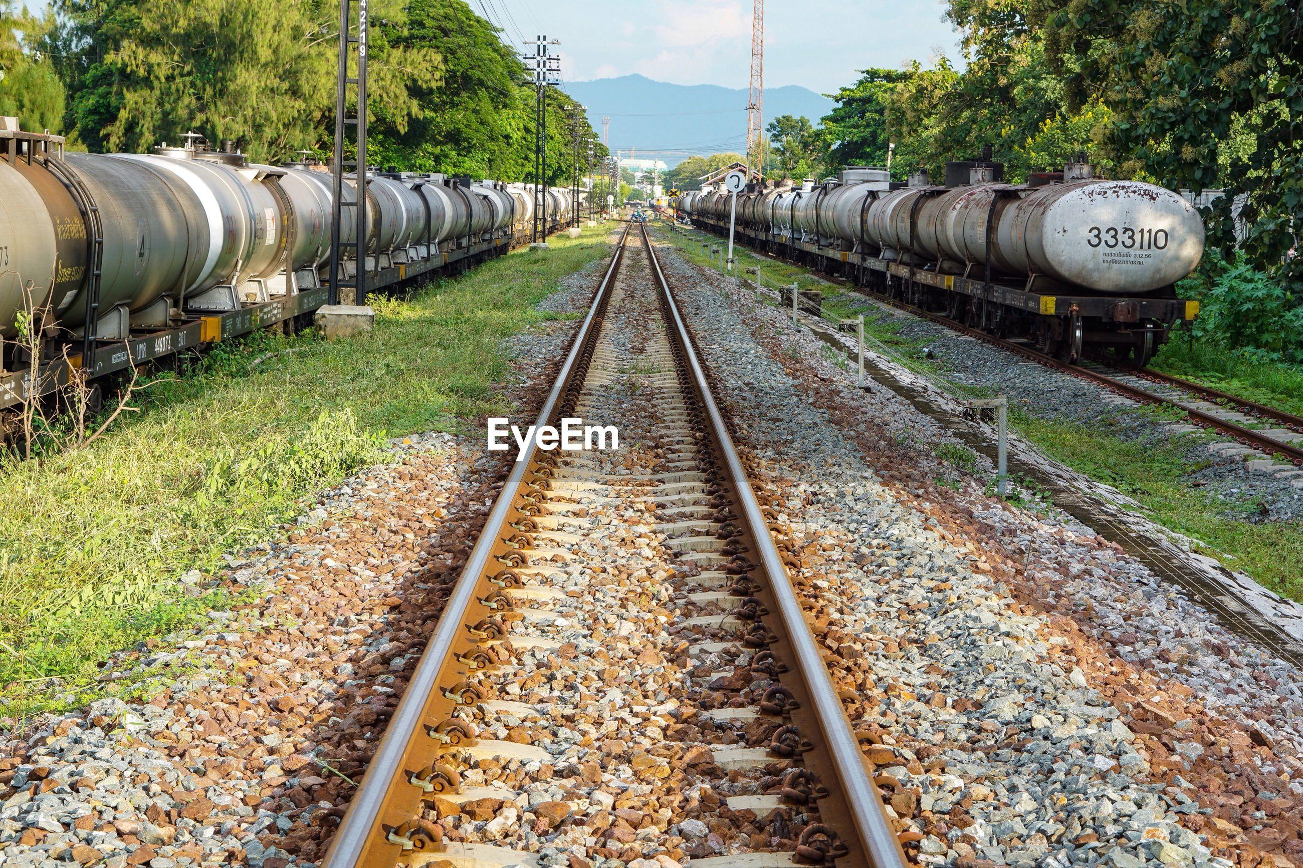TRAIN AT RAILROAD TRACK