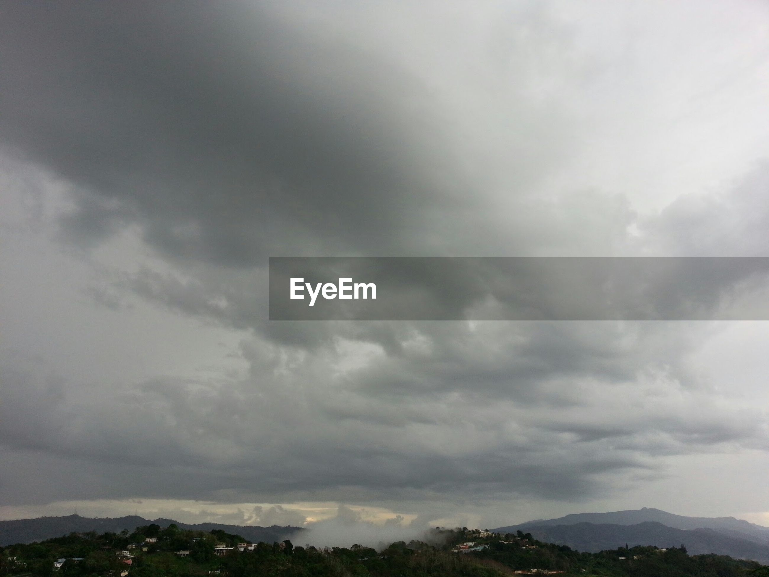 sky, cloudy, cloud - sky, scenics, tranquil scene, tranquility, mountain, beauty in nature, weather, nature, landscape, overcast, cloud, idyllic, mountain range, non-urban scene, cloudscape, day, outdoors, storm cloud