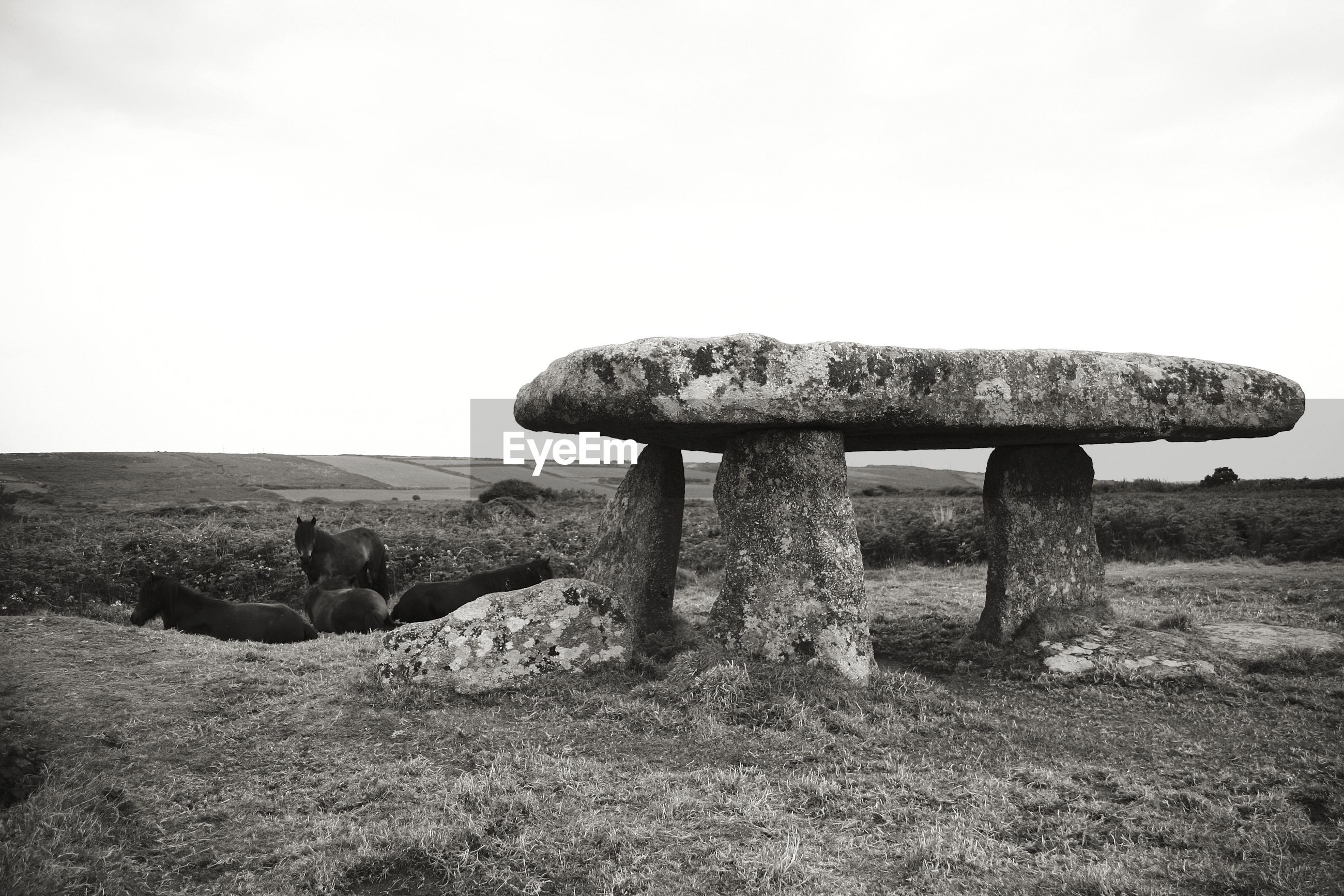 Stone structure on landscape against clear sky