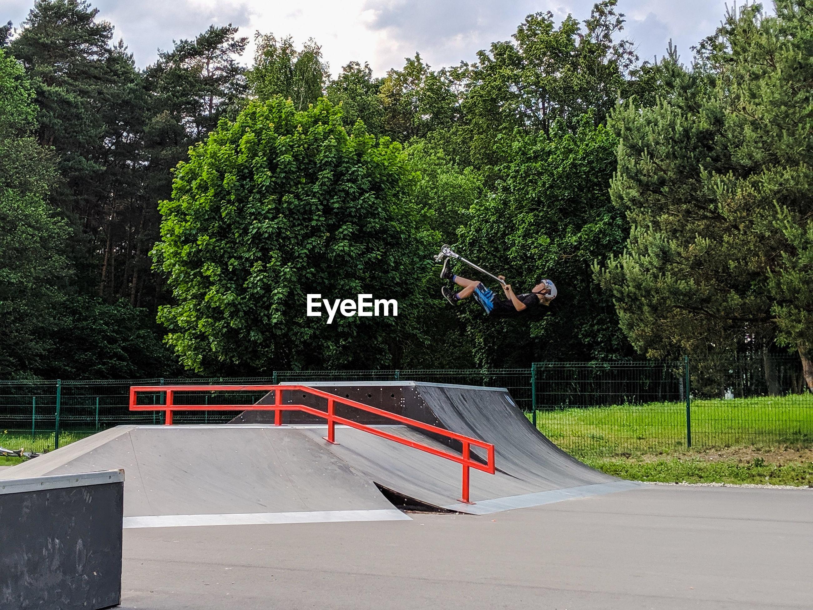 MAN JUMPING BY RAILING