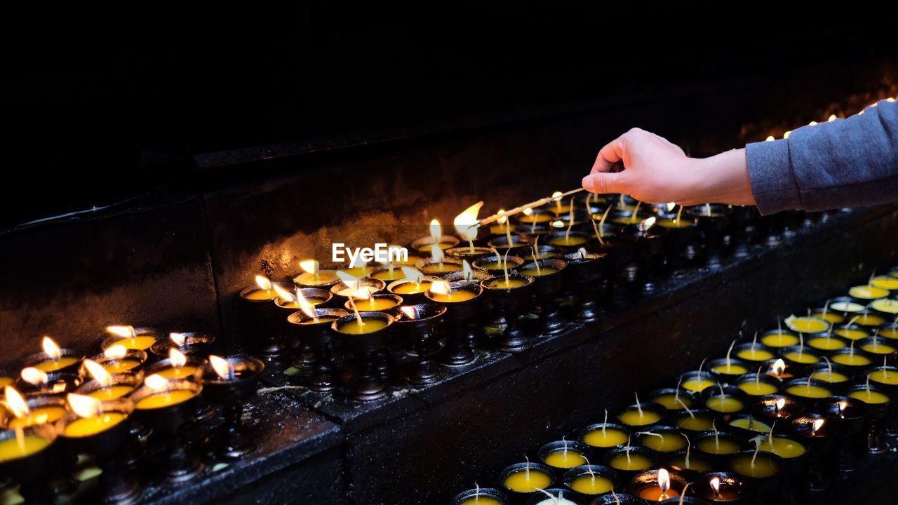 Cropped Hand Of Woman Burning Incense With Diya At Jokhang Temple