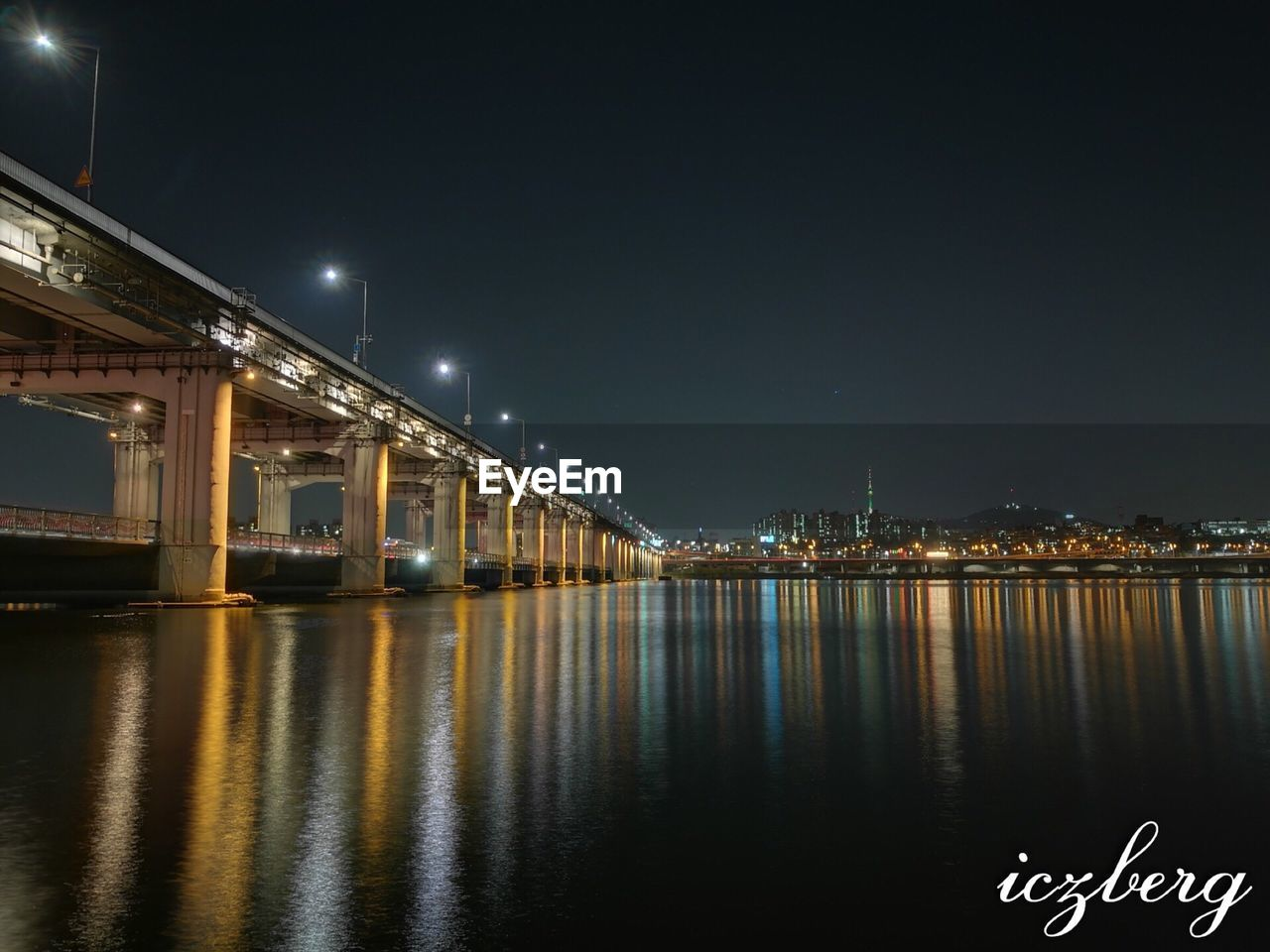 night, illuminated, architecture, built structure, reflection, building exterior, water, bridge - man made structure, city, river, street light, travel destinations, no people, outdoors, sky, cityscape