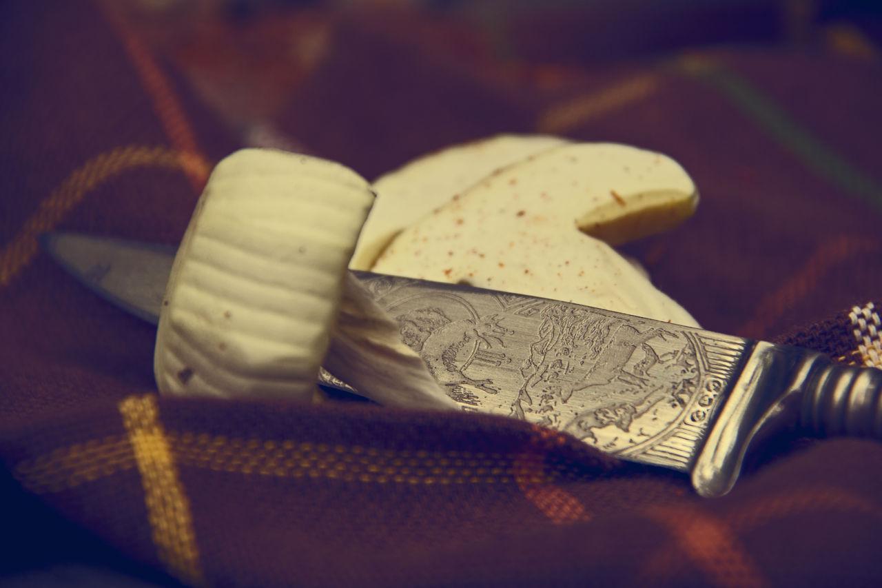 Close-Up Of Vintage Knife And Mushrooms On Napkin