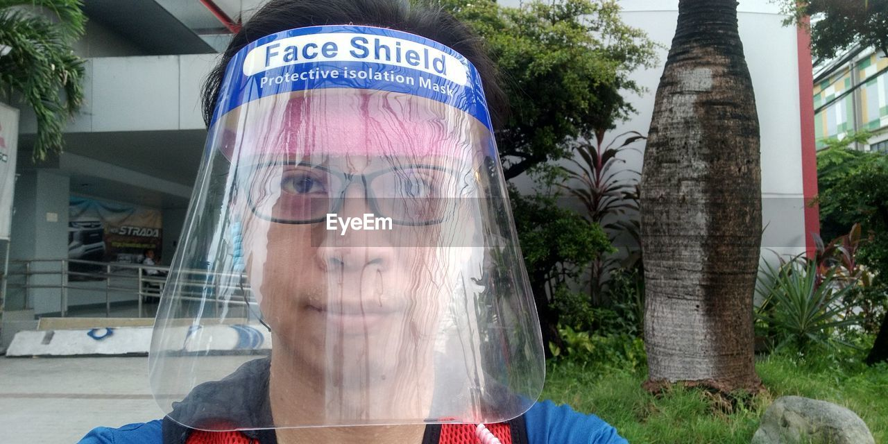 DIGITAL COMPOSITE IMAGE OF WOMAN LOOKING AT CAMERA