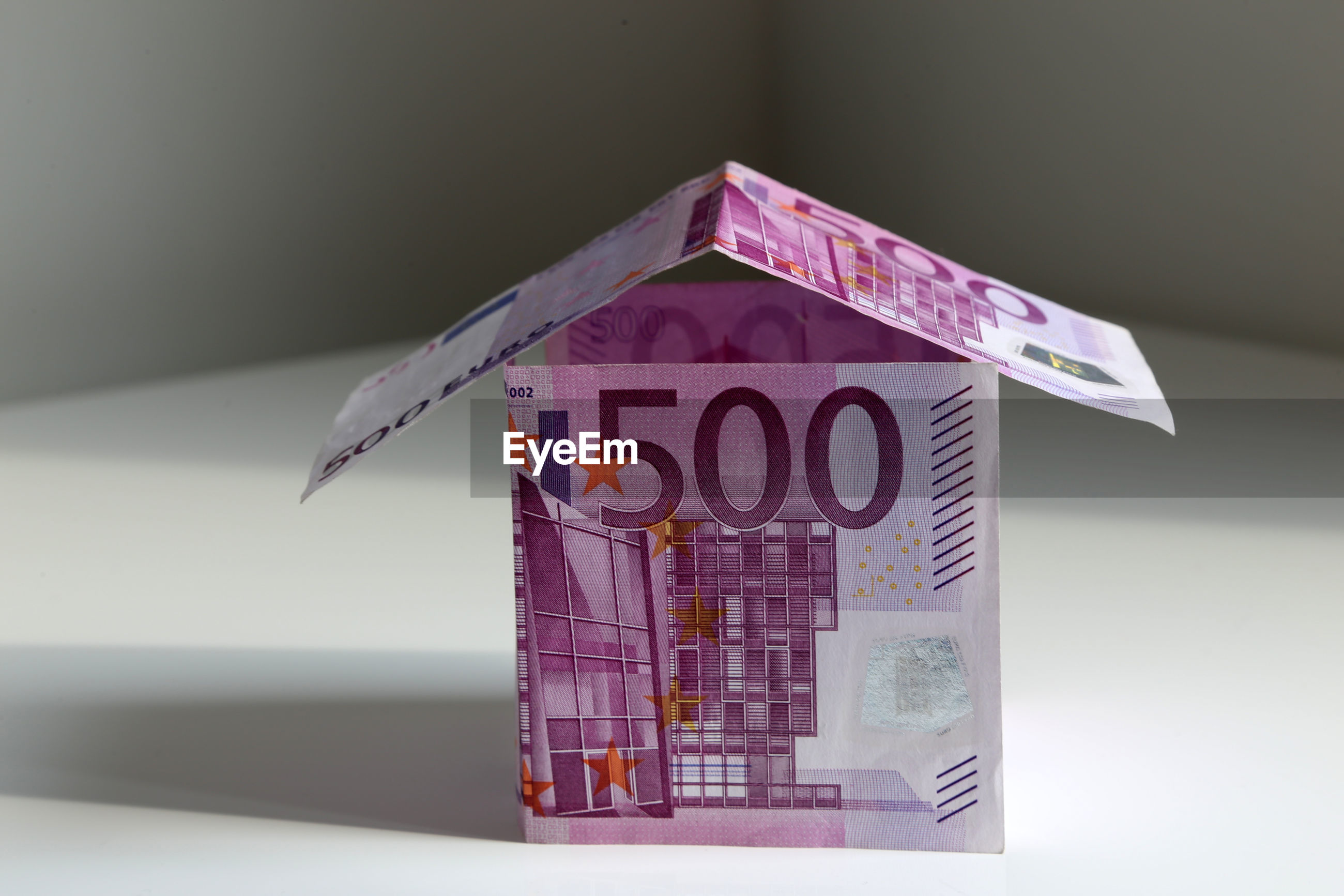 Close-up of house built from 500 euro banknotes