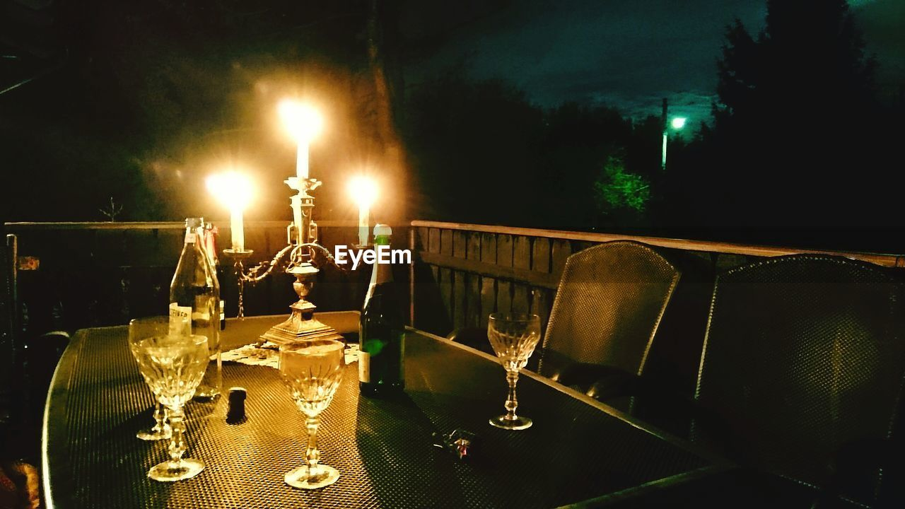Close-up of drinks on table in the dark