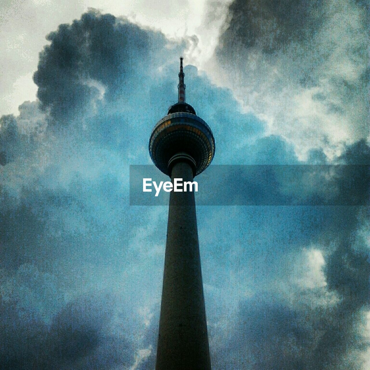 architecture, tall - high, built structure, spire, sky, low angle view, travel destinations, building exterior, cloud - sky, communication, television tower, outdoors, tower, tourism, no people, day, travel, city