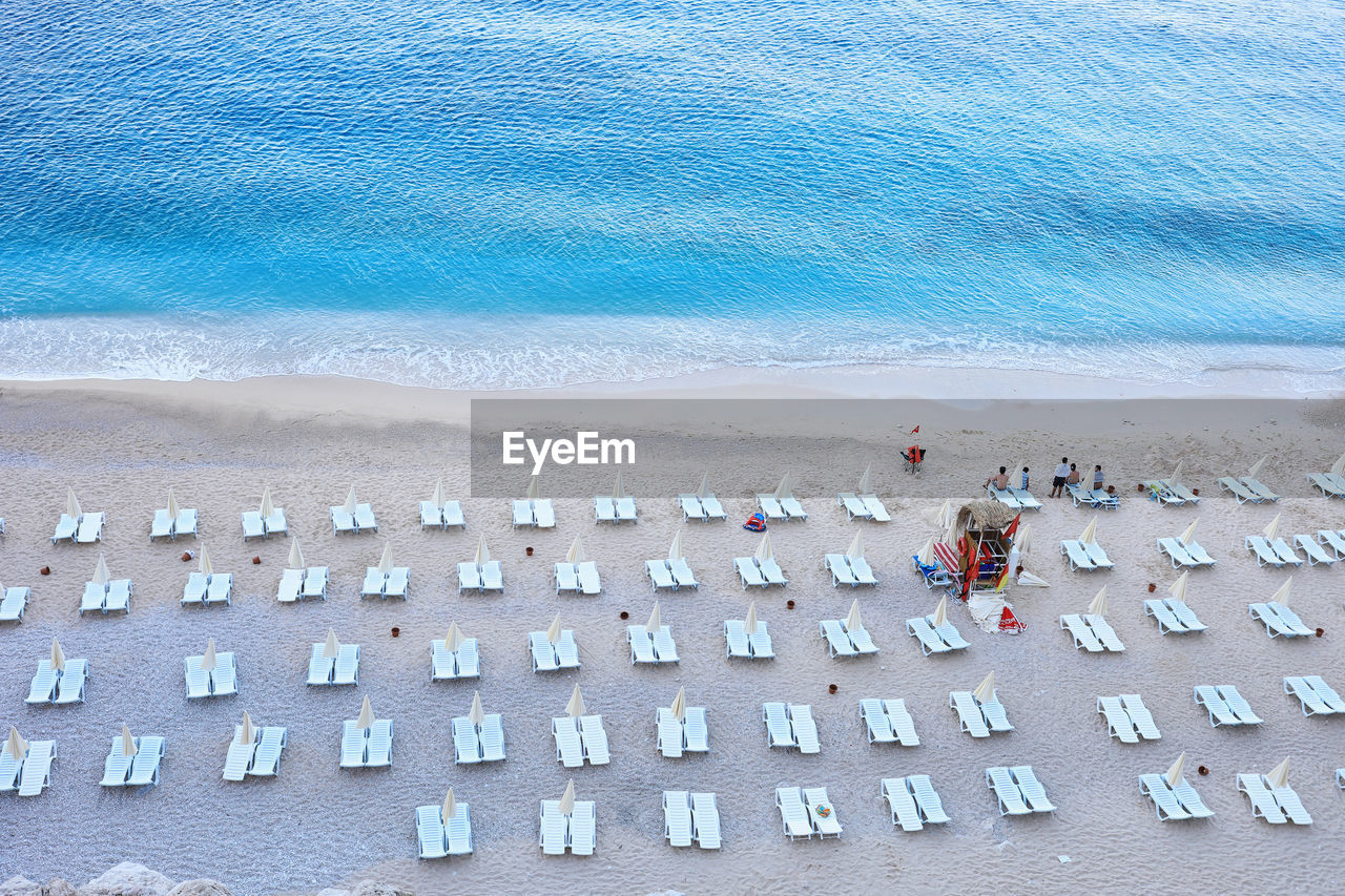 High Angle View Of Deck Chairs Arranged At Beach