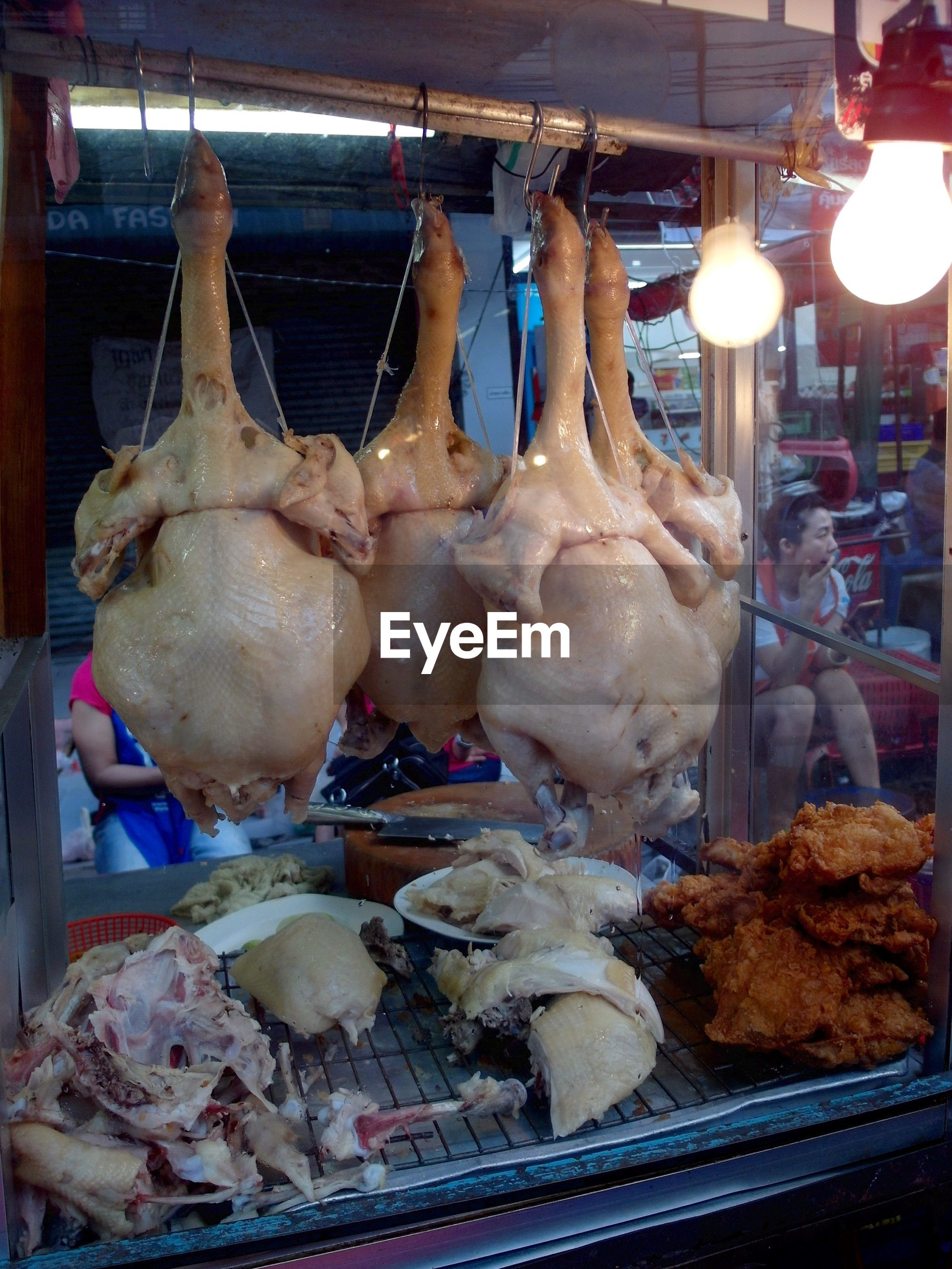 Cooked turkey meat in market stall
