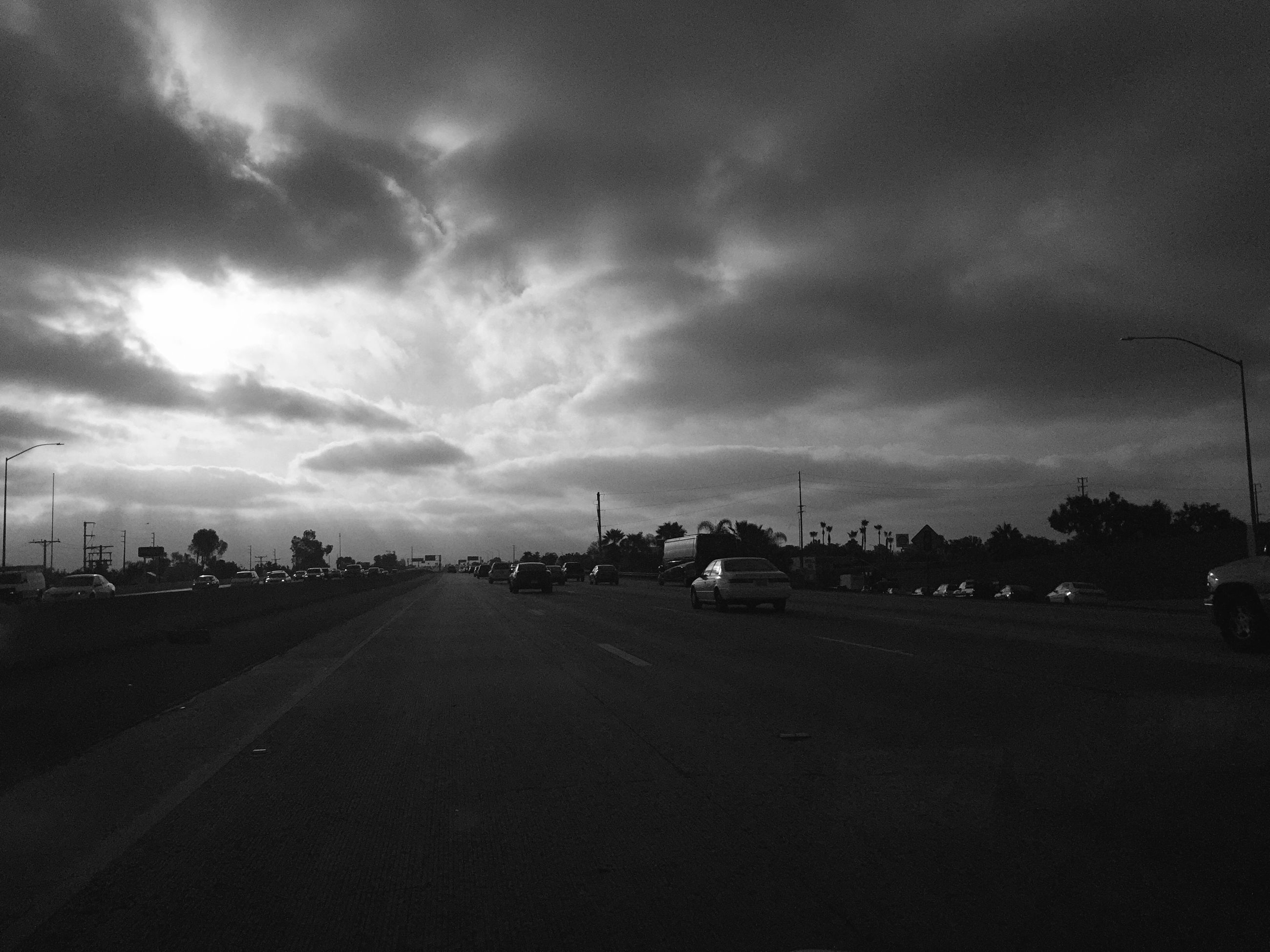 sky, transportation, road, cloud - sky, cloudy, the way forward, car, street, cloud, mode of transport, land vehicle, landscape, overcast, road marking, nature, tranquility, empty, outdoors, tranquil scene, weather