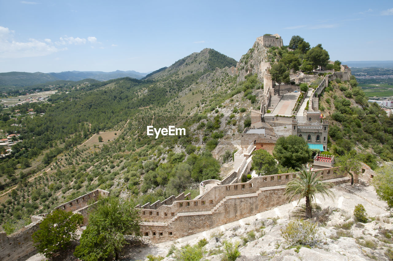 architecture, built structure, building exterior, mountain, plant, tree, sky, nature, day, building, scenics - nature, history, the past, high angle view, beauty in nature, travel, no people, travel destinations, environment, tourism, outdoors, ancient civilization