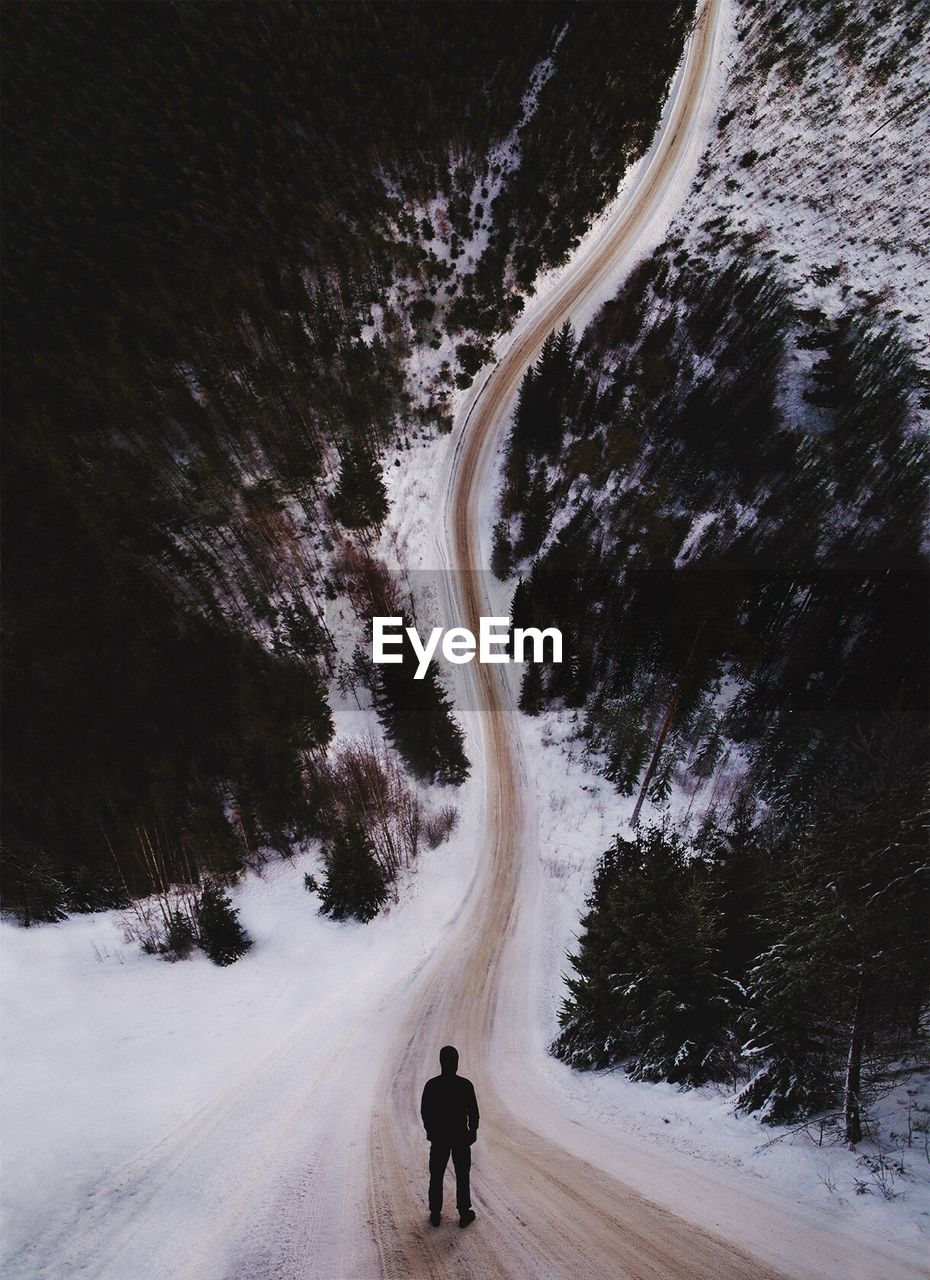 Full Length Of Man On Snow Covered Landscape