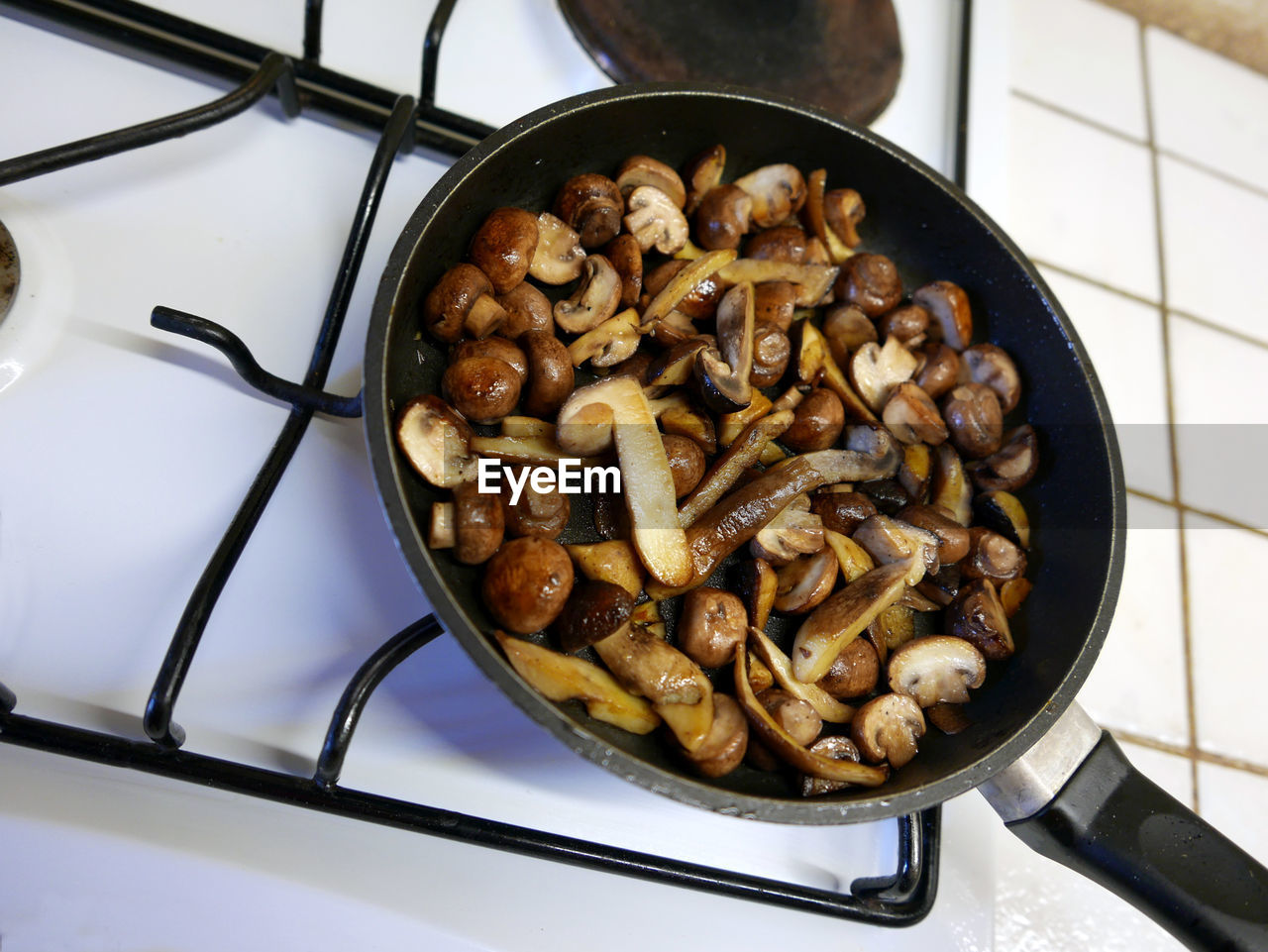 High Angle View Of Mushrooms In Cooking Pan On Stove