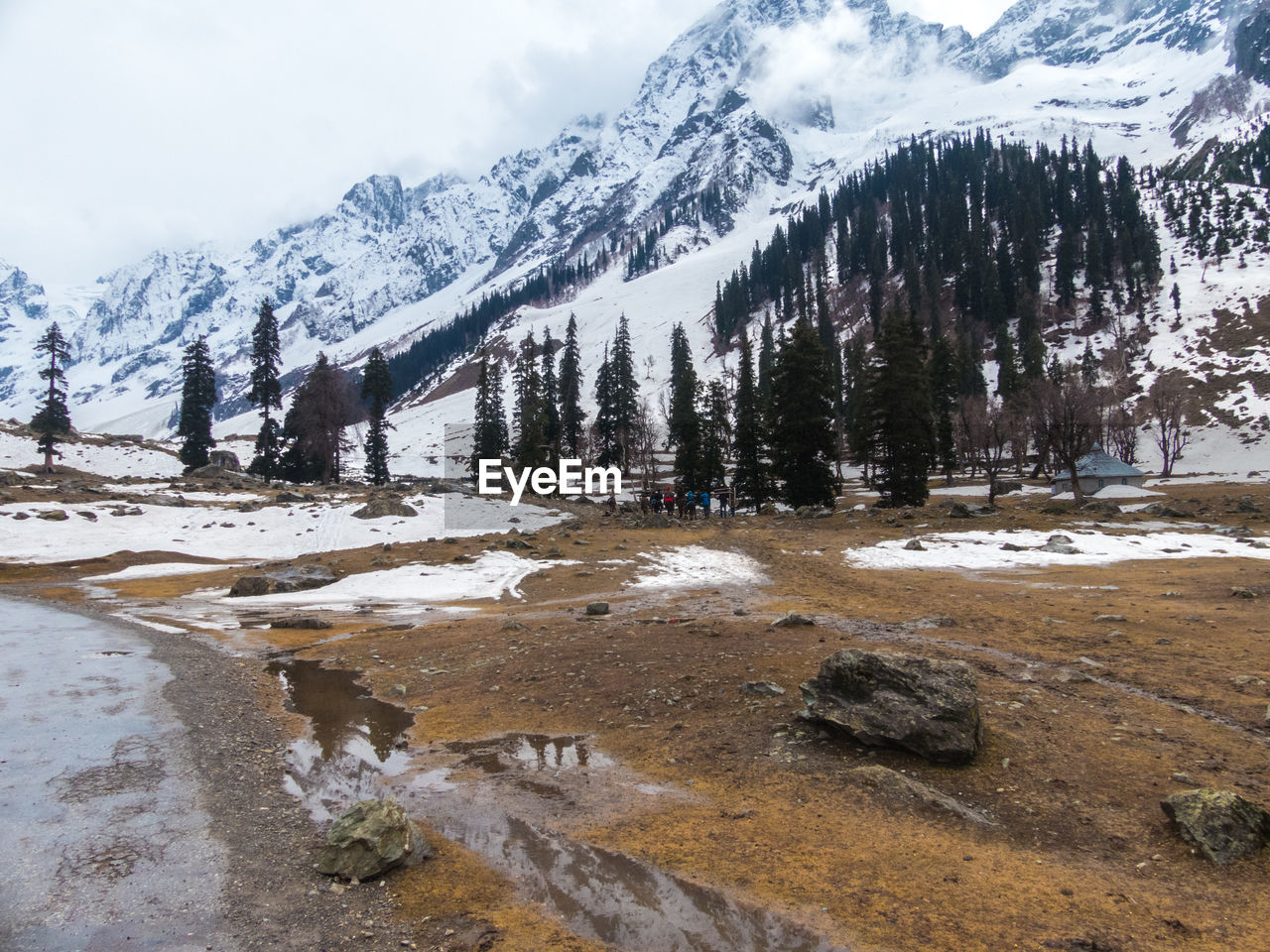 snow, cold temperature, mountain, winter, beauty in nature, sky, scenics - nature, tranquil scene, nature, tranquility, cloud - sky, water, day, tree, plant, no people, non-urban scene, land, rock, outdoors, snowcapped mountain, flowing water