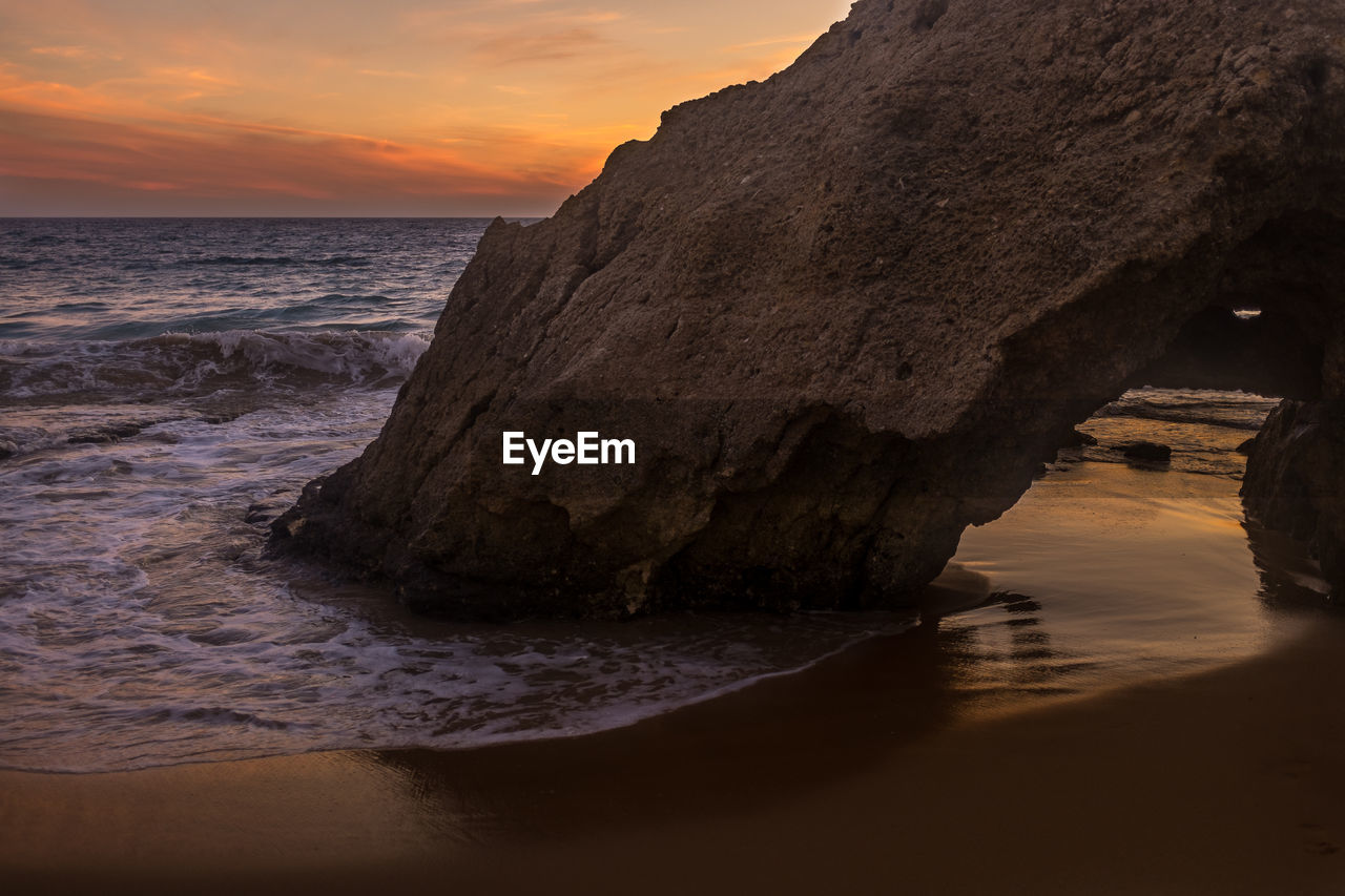 sea, sunset, beauty in nature, nature, scenics, water, horizon over water, tranquility, tranquil scene, rock formation, beach, rock - object, sky, idyllic, no people, wave, sand, outdoors, cliff, travel destinations, day