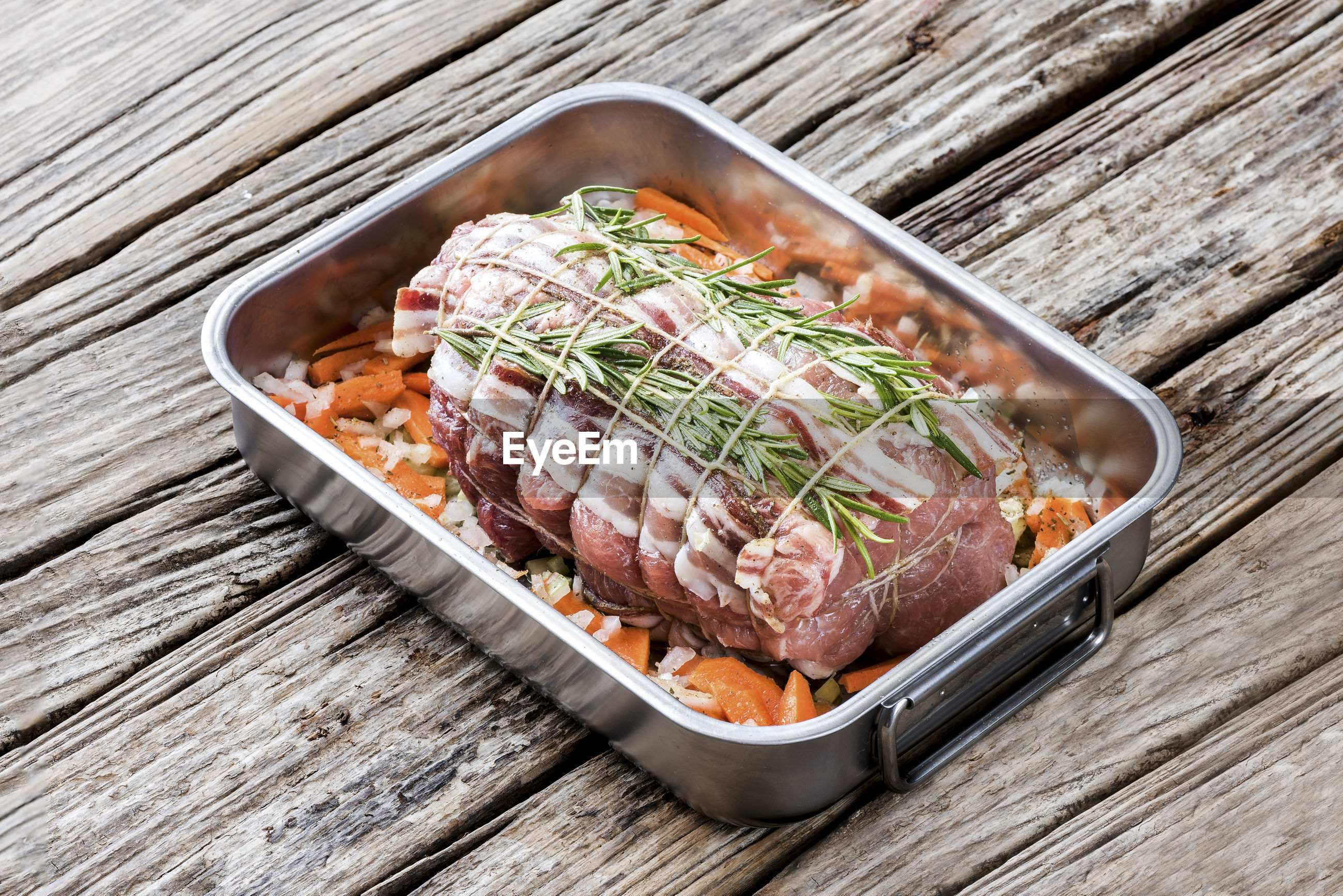 High angle view of meat in container on table