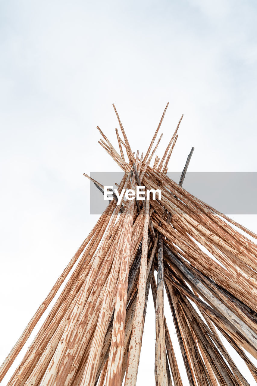 Low angle view of bamboo structure against sky