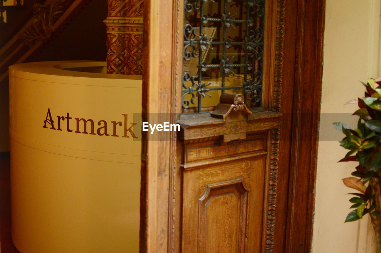 door, text, wood - material, communication, no people, brown, old-fashioned, close-up, indoors, architecture, day