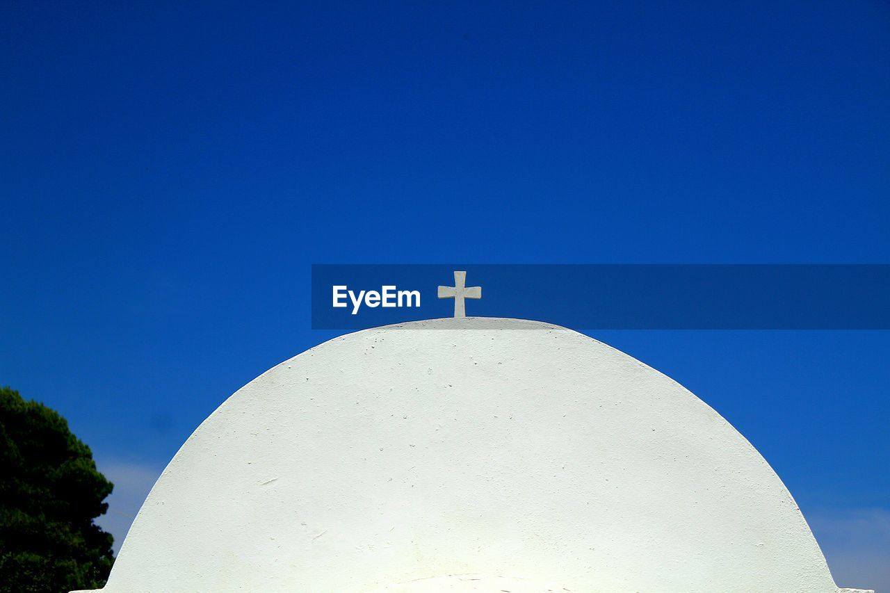 blue, sky, spirituality, religion, cross, belief, place of worship, built structure, copy space, architecture, no people, clear sky, building exterior, low angle view, nature, building, day, outdoors