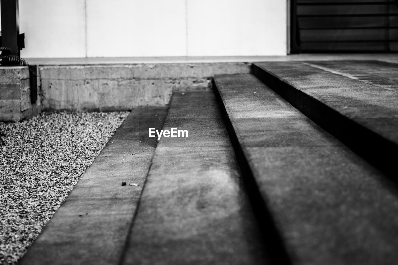 selective focus, no people, wood - material, indoors, day, close-up, surface level, flooring, architecture, built structure, absence, pattern, sunlight, wall - building feature, nature, footpath, textured, direction, the way forward
