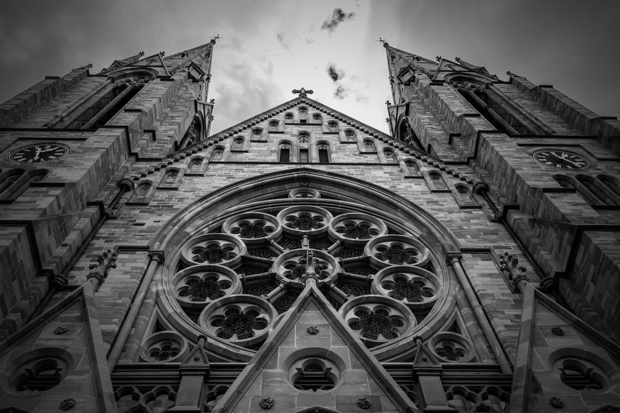 religion, place of worship, spirituality, architecture, rose window, built structure, low angle view, building exterior, history, sky, outdoors, no people, day, cloud - sky, travel destinations