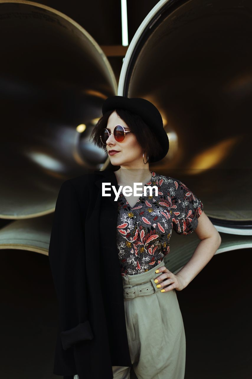 Fashionable young woman wearing sunglasses while standing outdoors
