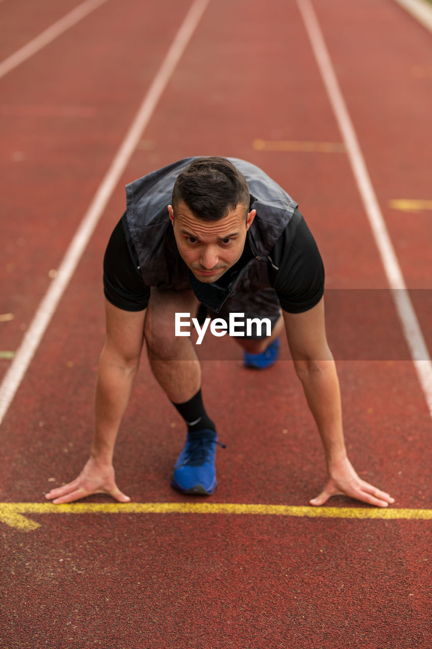 Full length of man on running track