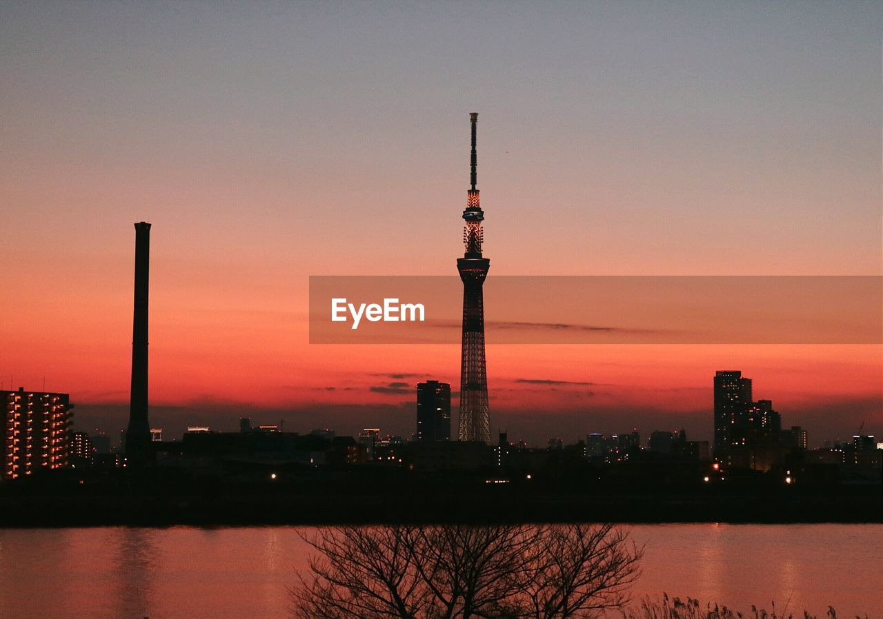 Tokyo Sky Tree By River Against Sky During Sunset In City
