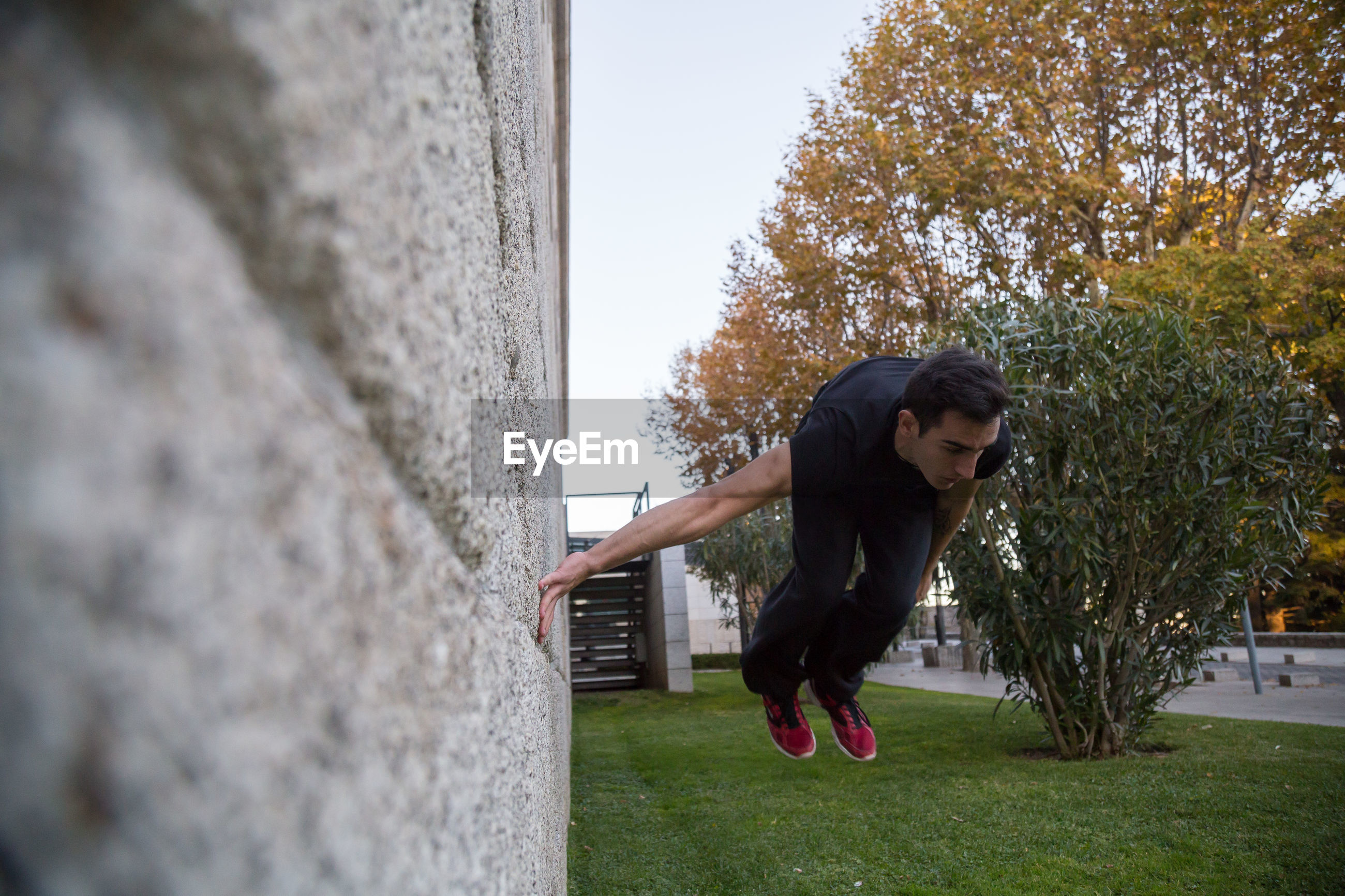 Man jumping by wall