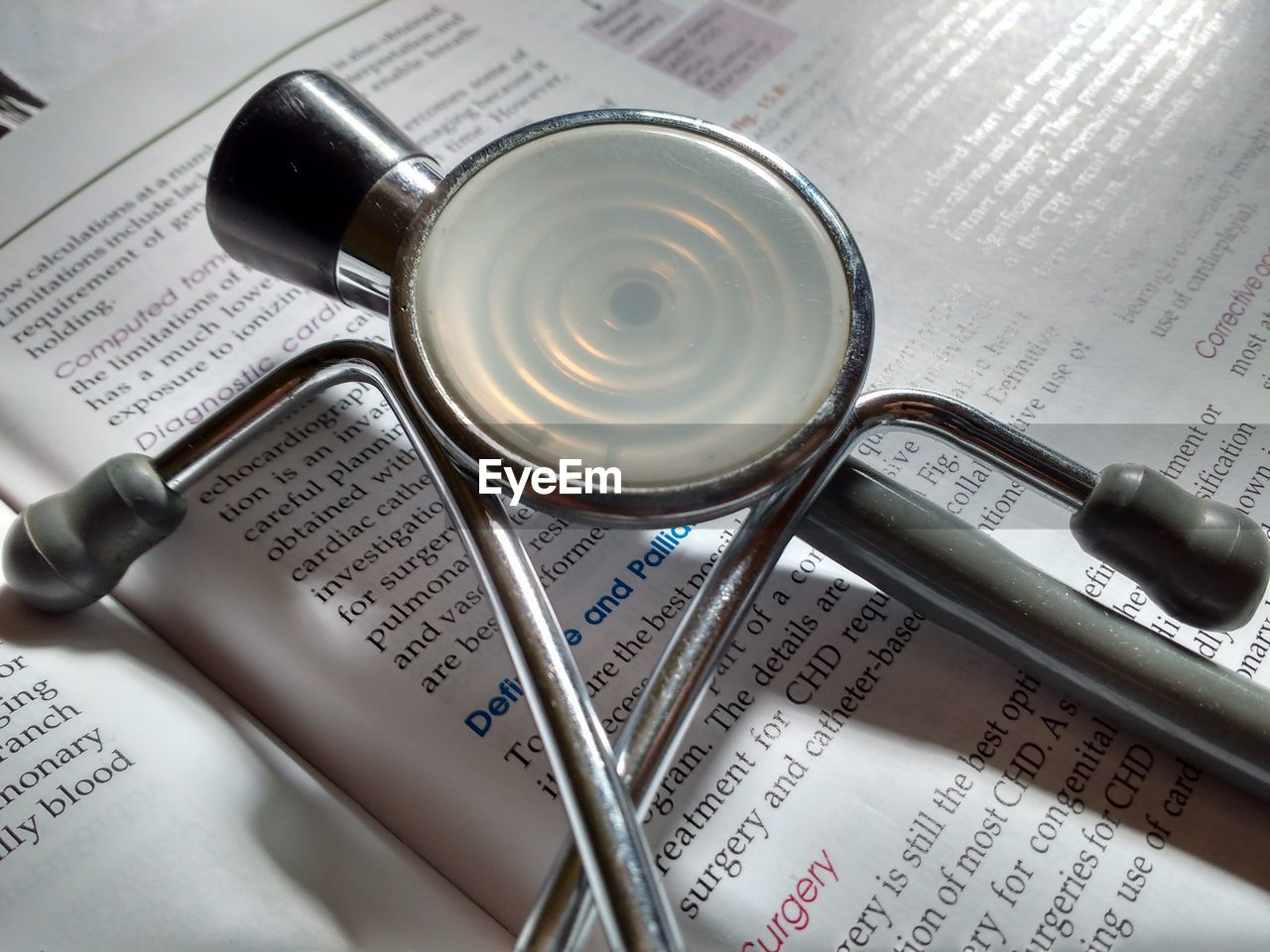 High Angle View Of Stethoscope On Book
