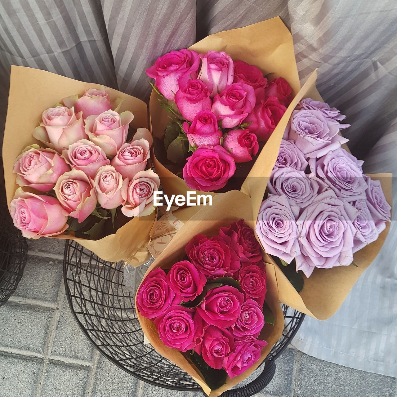 flower, flowering plant, pink color, rose, rose - flower, beauty in nature, plant, high angle view, vulnerability, inflorescence, flower head, fragility, petal, freshness, bouquet, flower arrangement, close-up, nature, no people, arrangement, bunch of flowers