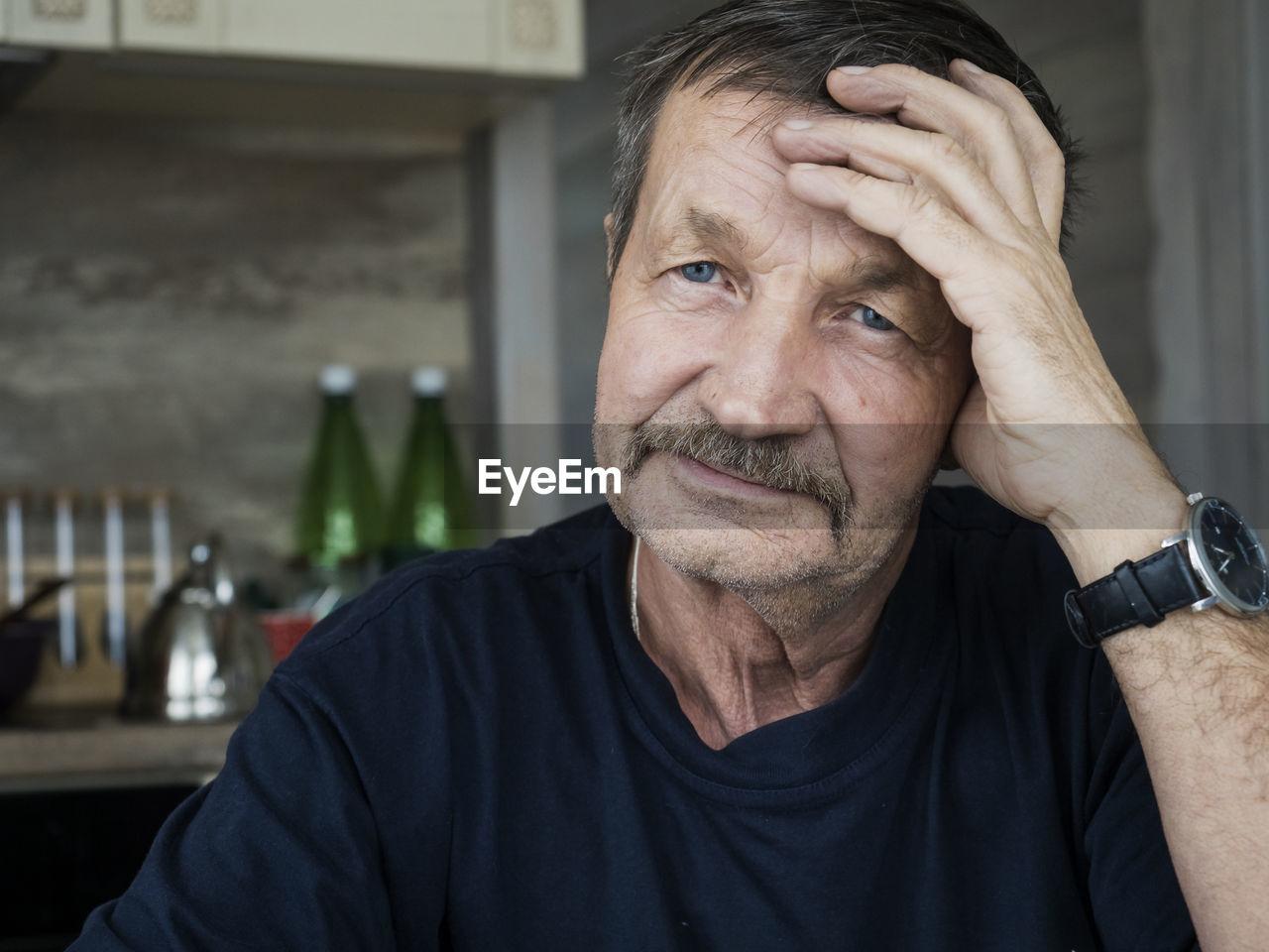 Portrait Of Senior Man In Kitchen At Home