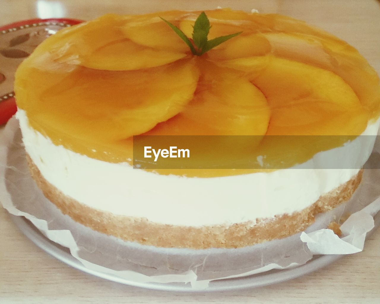 food and drink, sweet food, dessert, food, freshness, indoors, cake, indulgence, plate, table, fruit, serving size, unhealthy eating, ready-to-eat, temptation, sponge cake, no people, yellow, cheesecake, close-up, apple pie, tart - dessert, sweet pie, day