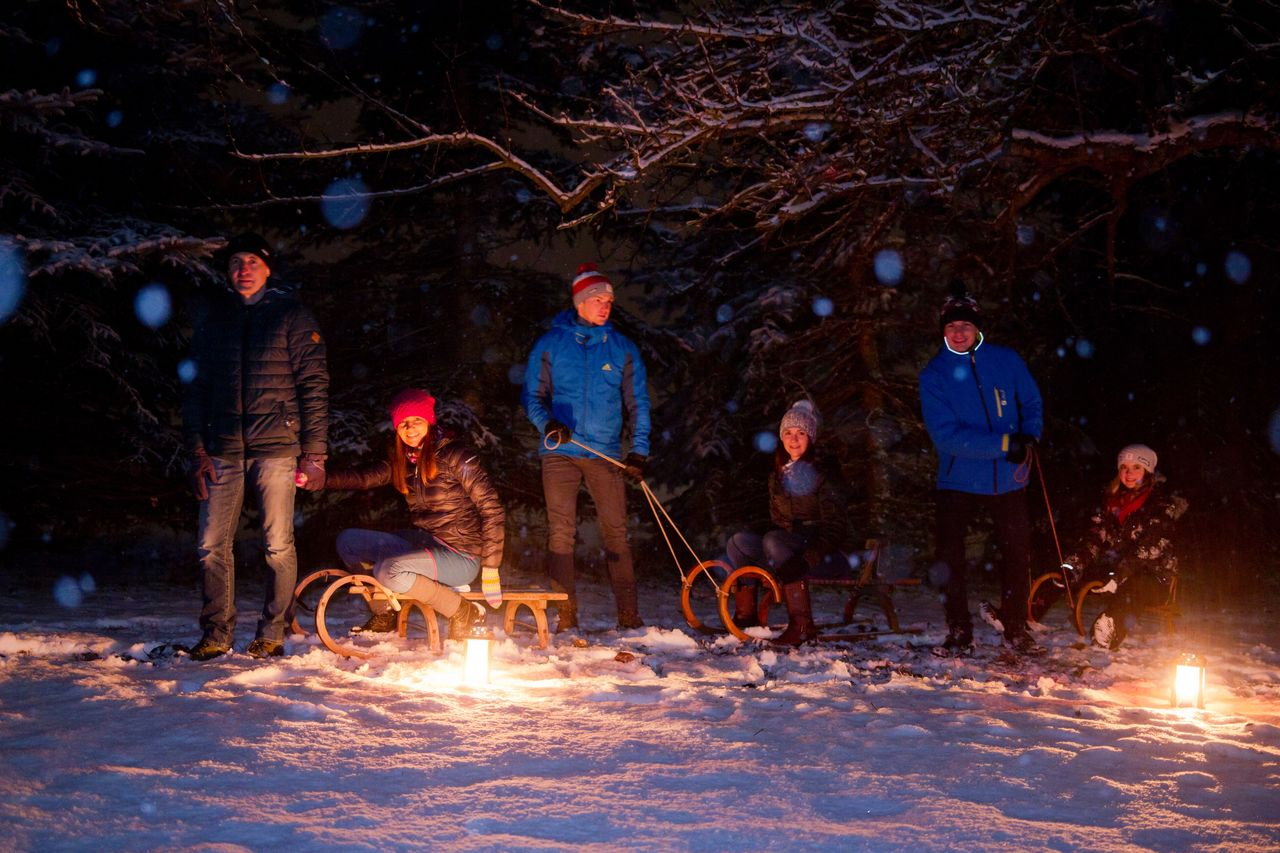 winter, snow, tree, cold temperature, night, nature, group of people, burning, illuminated, fire, full length, flame, men, warm clothing, fire - natural phenomenon, friendship, adult, leisure activity, campfire, outdoors, bonfire