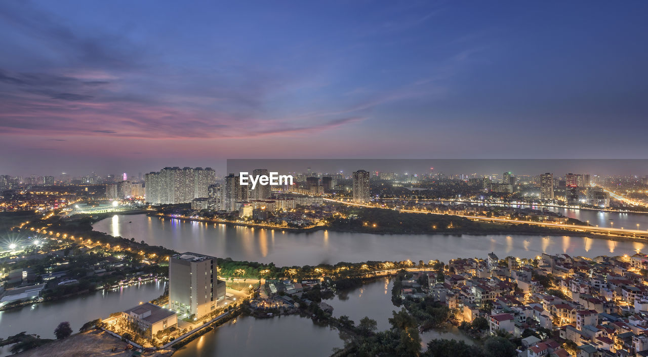 architecture, city, building exterior, built structure, sky, cityscape, illuminated, water, nature, building, night, no people, river, cloud - sky, office building exterior, dusk, connection, residential district, outdoors, skyscraper, modern, bay