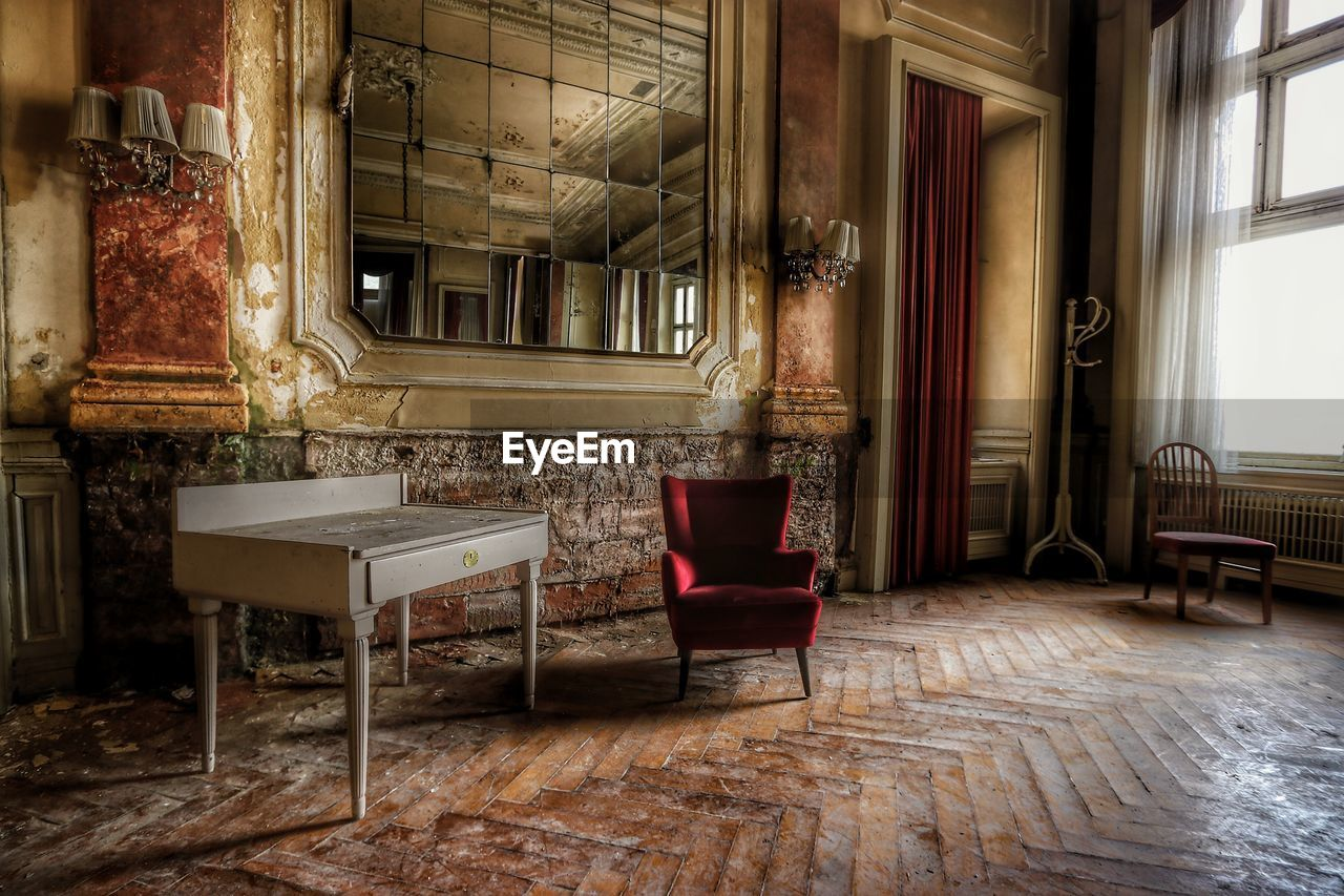 seat, chair, indoors, furniture, flooring, window, absence, empty, no people, architecture, table, old, building, built structure, wood - material, living room, day, domestic room, home interior, house