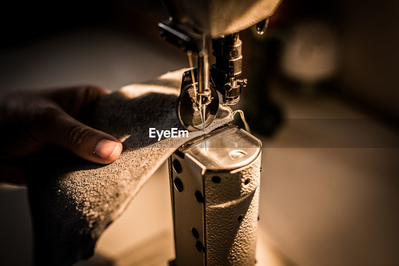Close-Up Of Person Working At Sewing Machine