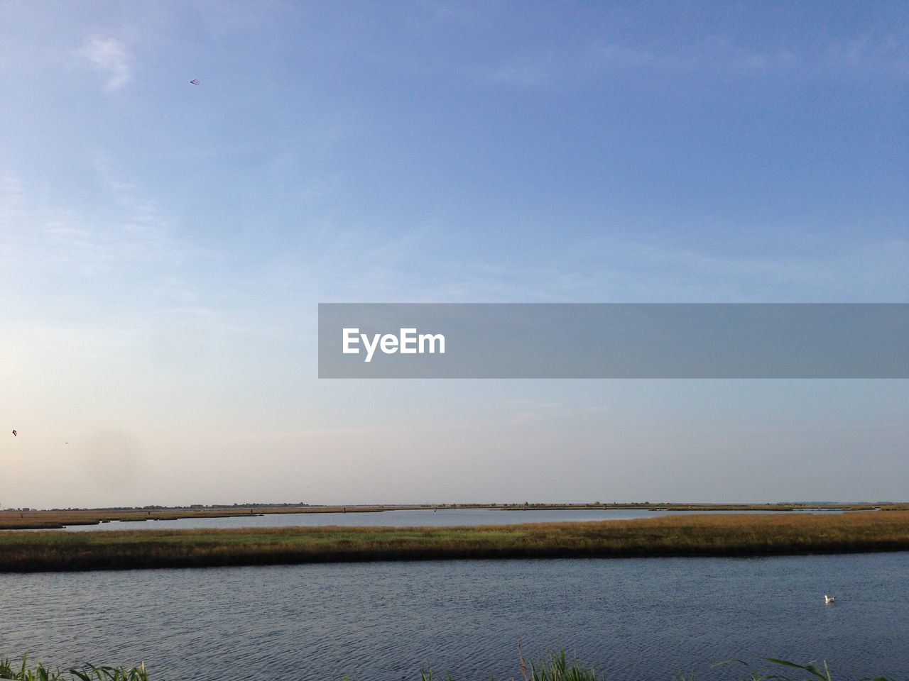 water, sky, beauty in nature, scenics - nature, tranquility, tranquil scene, sea, nature, non-urban scene, horizon, waterfront, day, cloud - sky, no people, idyllic, land, outdoors, remote, horizon over water