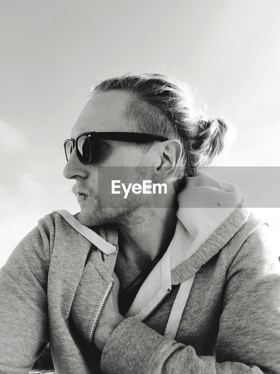 Low Angle View Of Young Man Wearing Sunglasses Against Sky