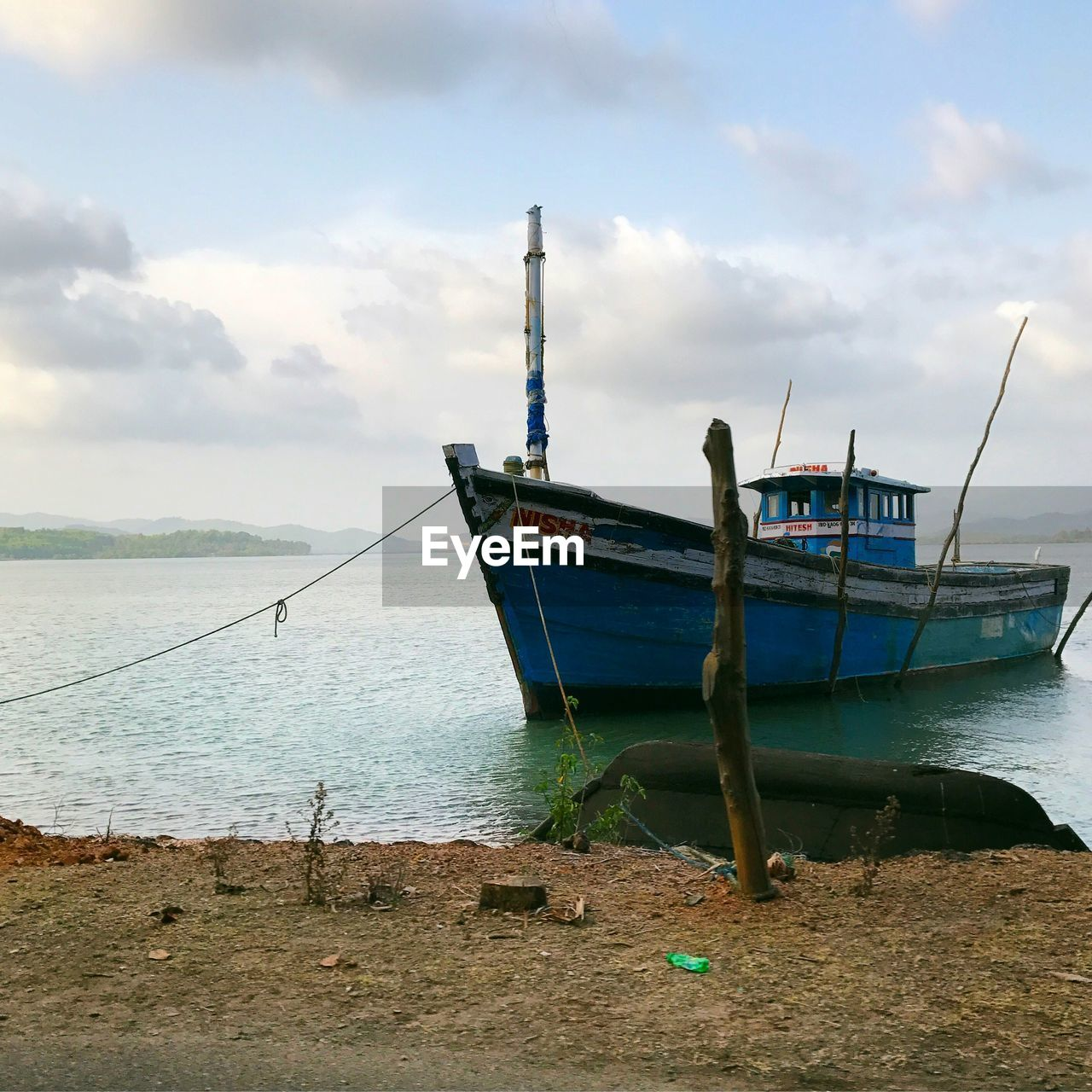 nautical vessel, water, transportation, sky, cloud - sky, mode of transportation, sea, moored, nature, beach, no people, scenics - nature, day, tranquility, horizon, tranquil scene, beauty in nature, horizon over water, land, outdoors, fishing industry, fishing boat, anchored