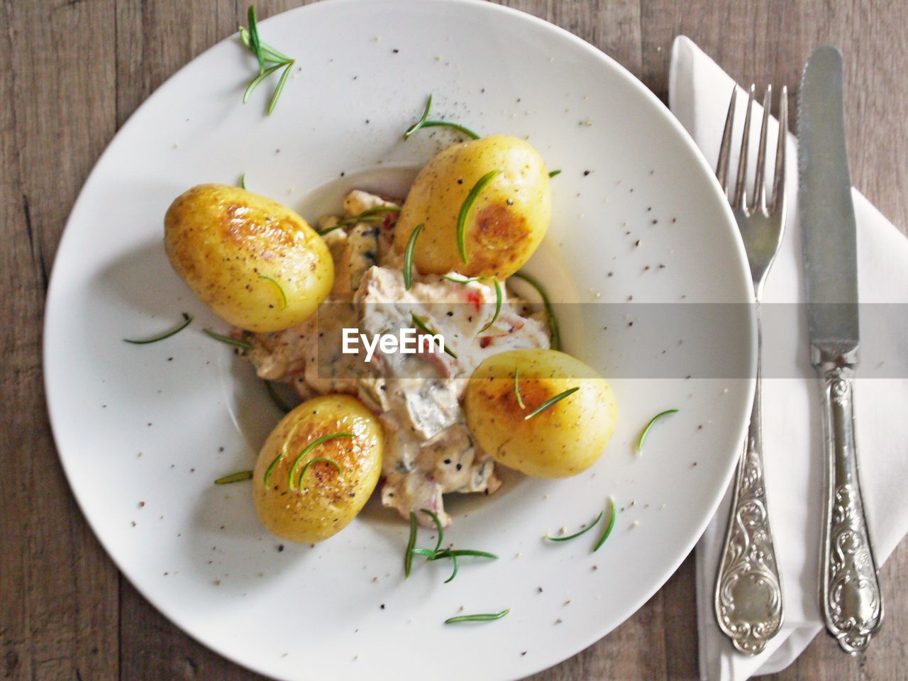 plate, food and drink, fork, food, healthy eating, freshness, table, indoors, seafood, high angle view, ready-to-eat, no people, brussels sprout, poached, close-up, day