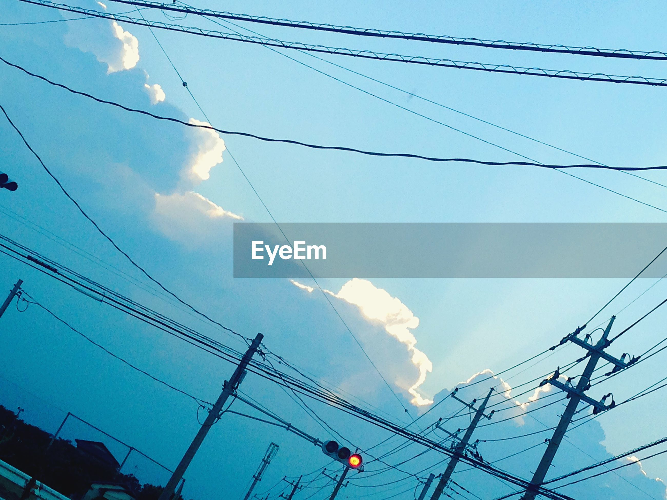 power line, power supply, low angle view, electricity, electricity pylon, cable, connection, fuel and power generation, technology, sky, power cable, complexity, blue, cloud - sky, wire, day, cloud, outdoors, no people, telephone line