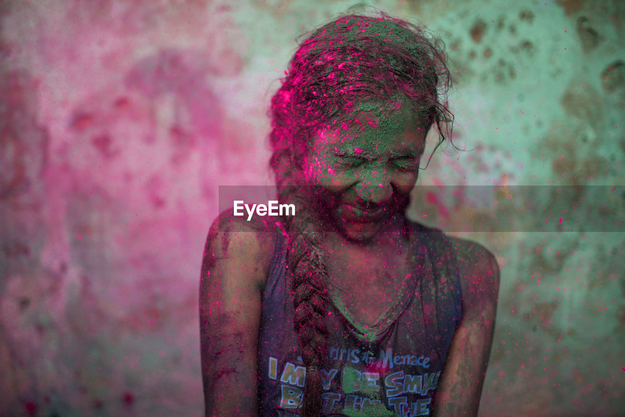 holi, celebration, powder paint, traditional festival, one person, messy, cultures, fun, face powder, front view, body paint, happiness, real people, standing, headshot, talcum powder, young adult, outdoors, lifestyles, multi colored, day, adult, close-up, people, adults only